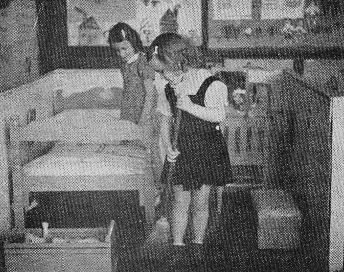 Little housekeepers in first grade are shown in this photo from 1940 or 1941. They are Priscilla Catoe and Betty Lynn. The photograph won a prize.
