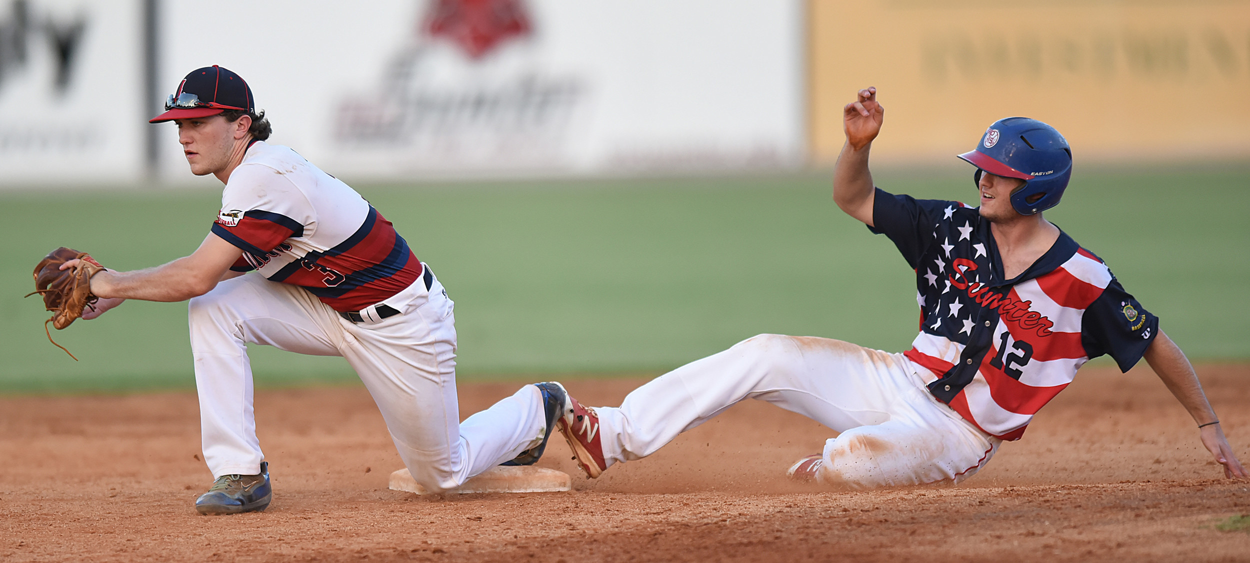 Lexington second baseman Dalton Lansdowne makes a catch to force out Sumter's Dawson Price at second in the P-15's 12-3 win on Friday at Riley Park. The P-15's swept the best-of-5 second-round state playoffs series.