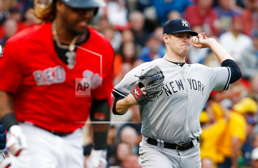 New York Yankee pitcher Jordan Montgomery throws to first base on a groundout by Boston's Hanley Ramirez, left, in the Red Sox's 5-4 win on Friday at Fenway Park in Boston.