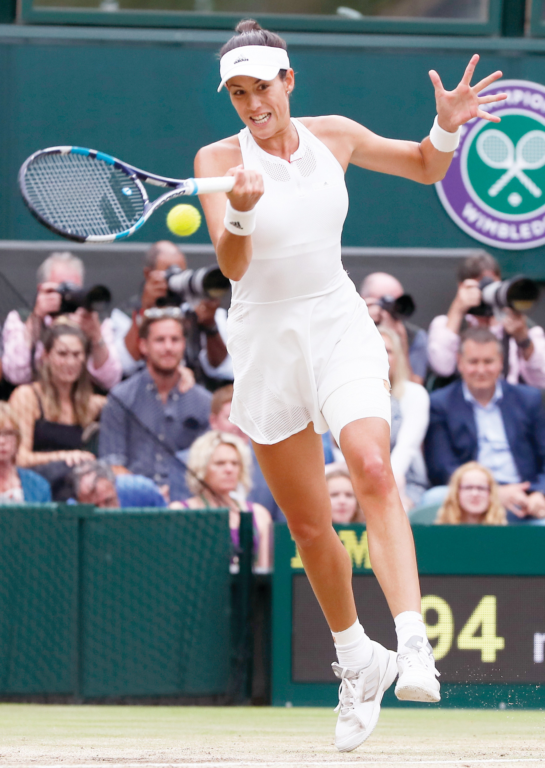 Garbine Muguruza hits a return to Venus Williams during her 7-5, 6-0 victory in the Wimbledon women's singles final on Saturday in London.