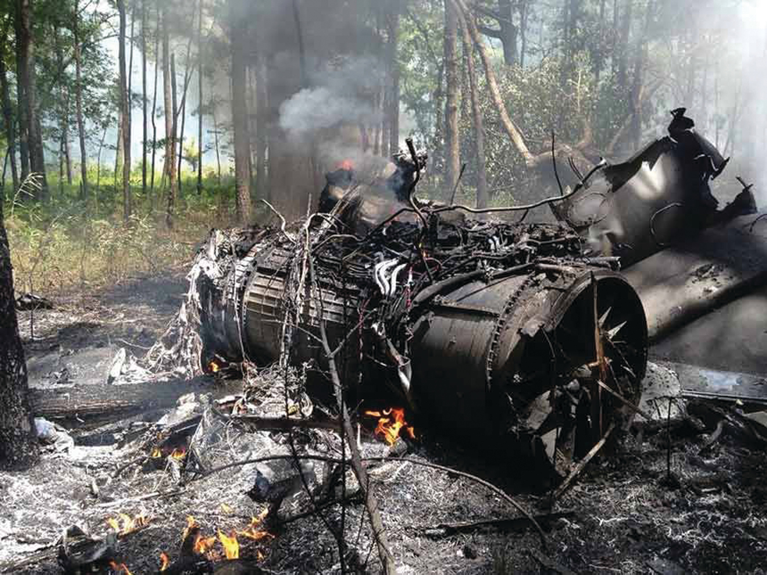 Wreckage is shown from the mid-air collision between a Shaw Air Force Base F-16 fighter jet and a private Cessna passenger plane over Berkeley County on July 7, 2015. The Cessna was completely destroyed in the crash, killing both people on board. The pilot of the F-16, Maj. Aaron Johnson of the 55th Fighter Squadron, ejected to safety.