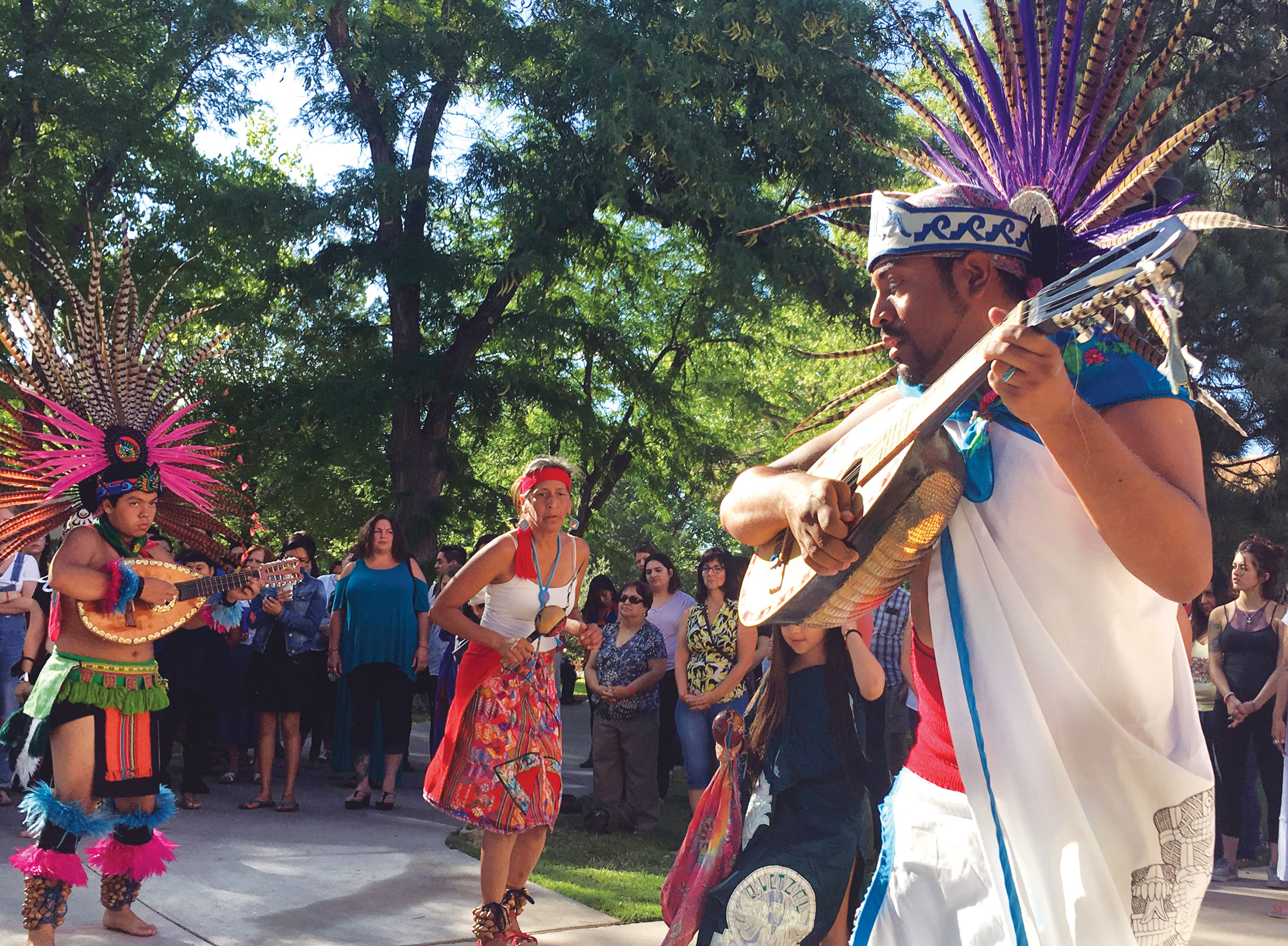 "An Aztec dancer participates in a ceremony on Monday at the University of New Mexico in Albuquerque as part of school's annual class on Curanderismo indigenous healing methods from the American Southwest and Latin America. A new textbook by the workshop's founder, Eliseo ""Cheo"" Torres, was released this month to coincide with the annual gathering."