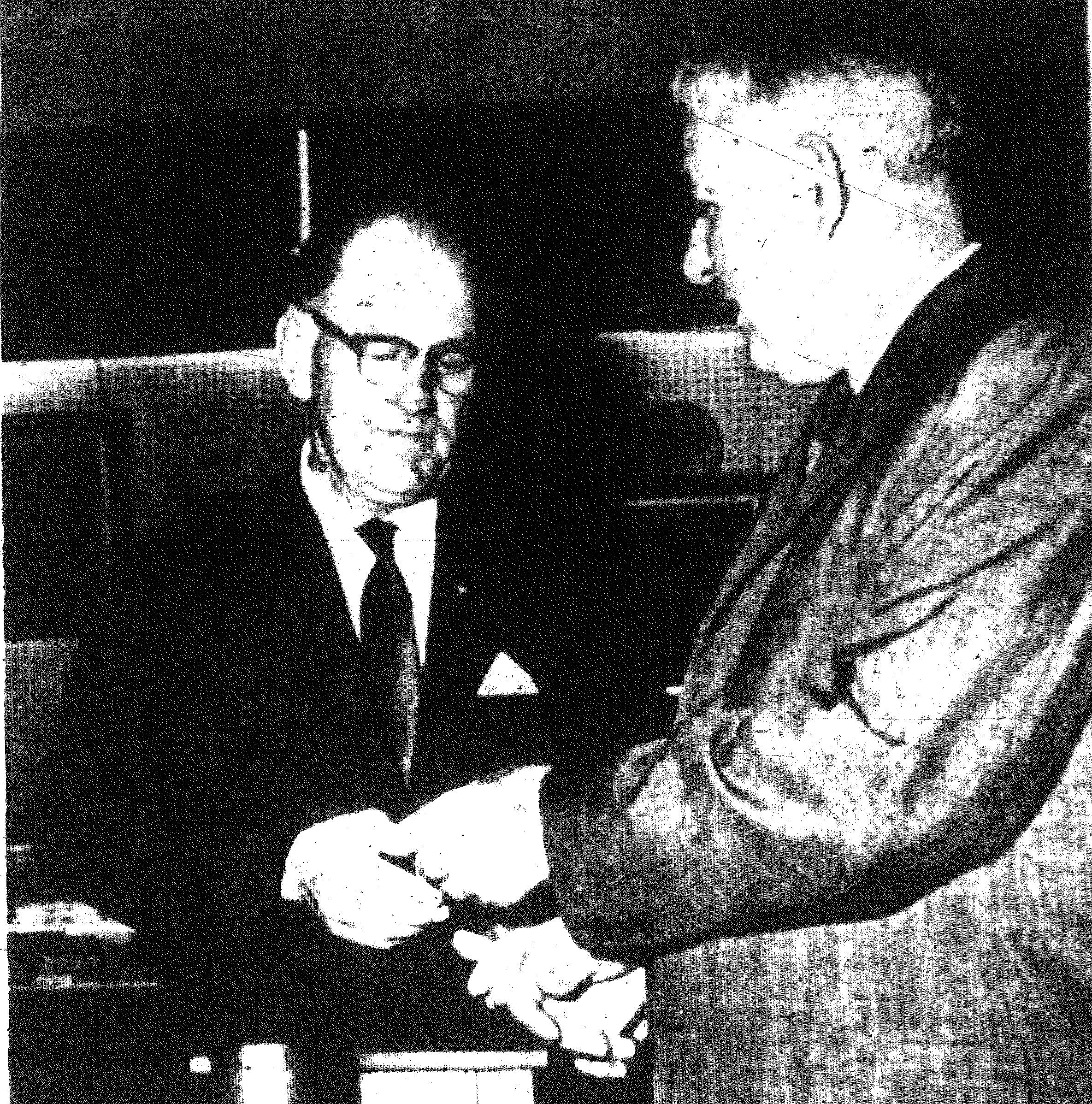 Kermit Ward, left, takes tickets and greets moviegoers, including John Galloway, for the last time at the Sumter Theatre on Oct. 5, 1967.