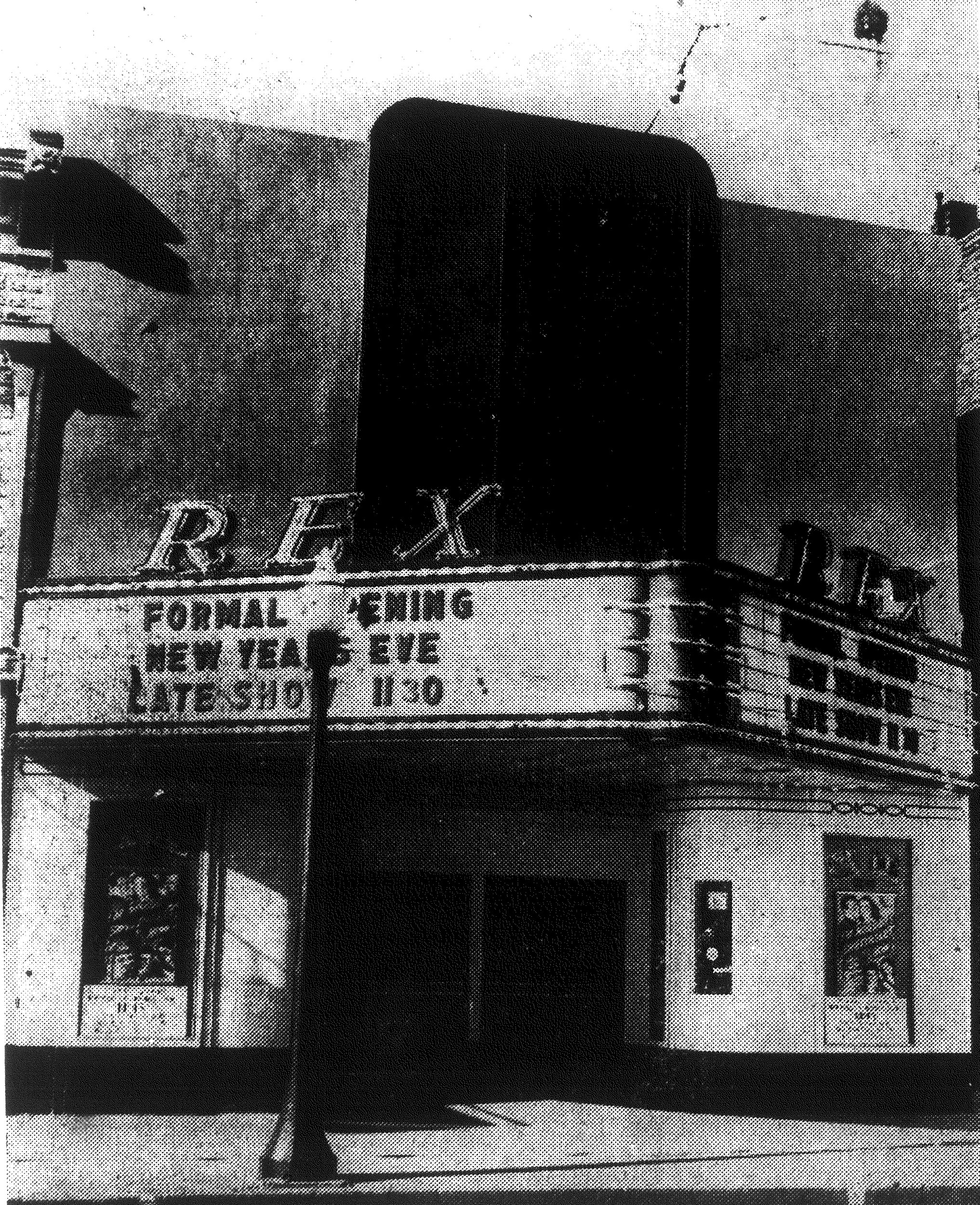 The exterior of the newly rebuilt and remodelled Rex Theater is shown the day of its formal opening on Dec. 31, 1940. The front is constructed of porcelain enamel, a beautiful and enduring material being used for the first time in South Carolina for a theater front.