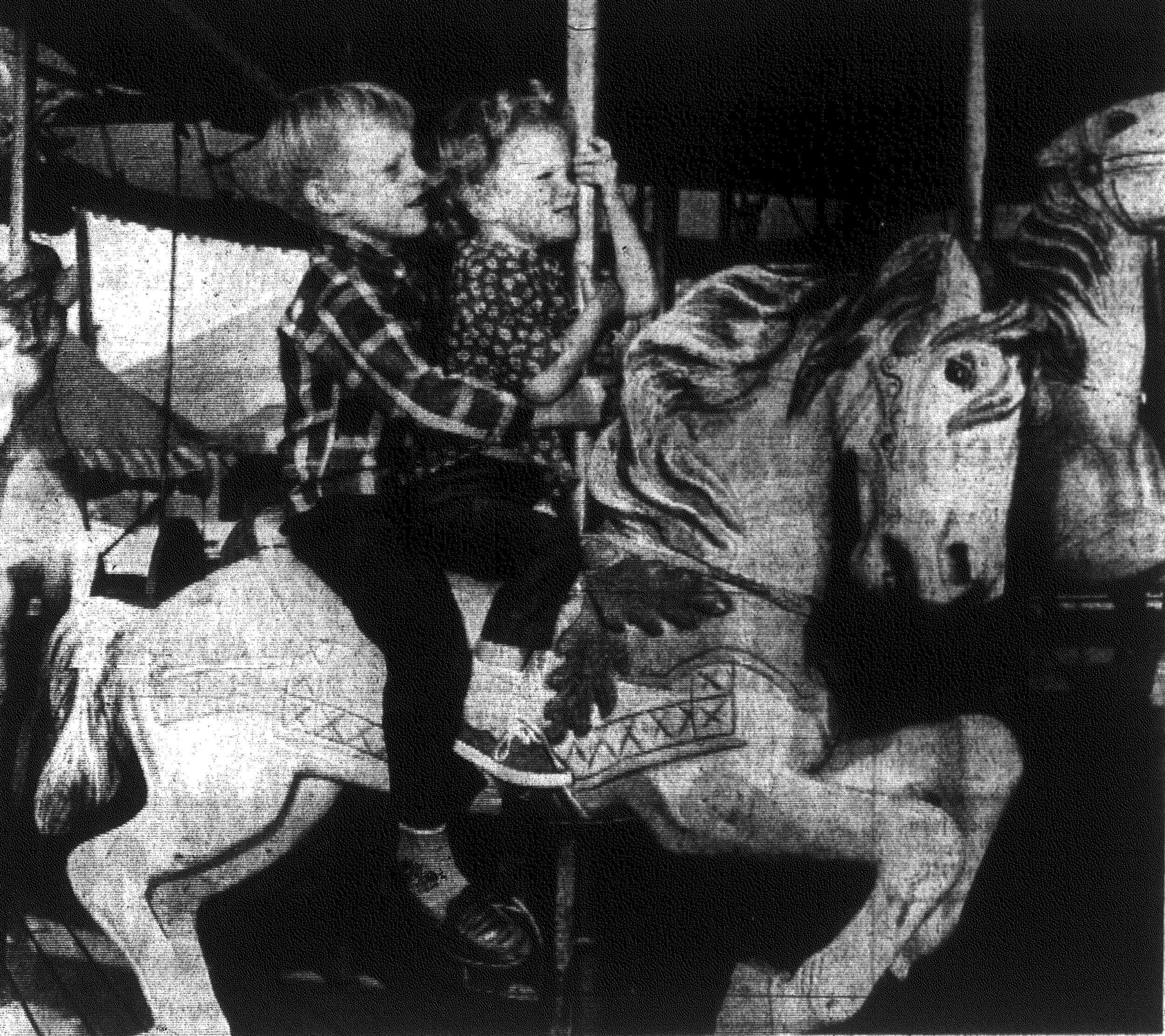 1967 -- Delgar Fowler, 6, and his sister Susan, 3, watch the world go by as they enjoy the merry-go-round at the Sumter County Fair. They were two of hundreds of youngsters enjoying the annual event presented by American Legion Post 15. Their parents are Mr. and Mrs. Nick Fowler.