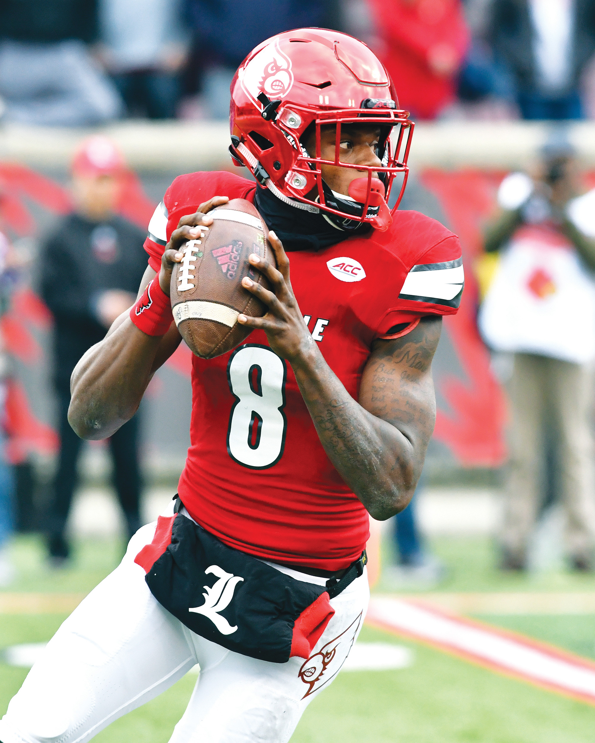 Louisville's Lamar Jackson (8) looks for an open receiver during a game against Kentucky in Louisville. Jackson won the Heisman Trophy last year and has a chance to become only the second two-time winner of the award.