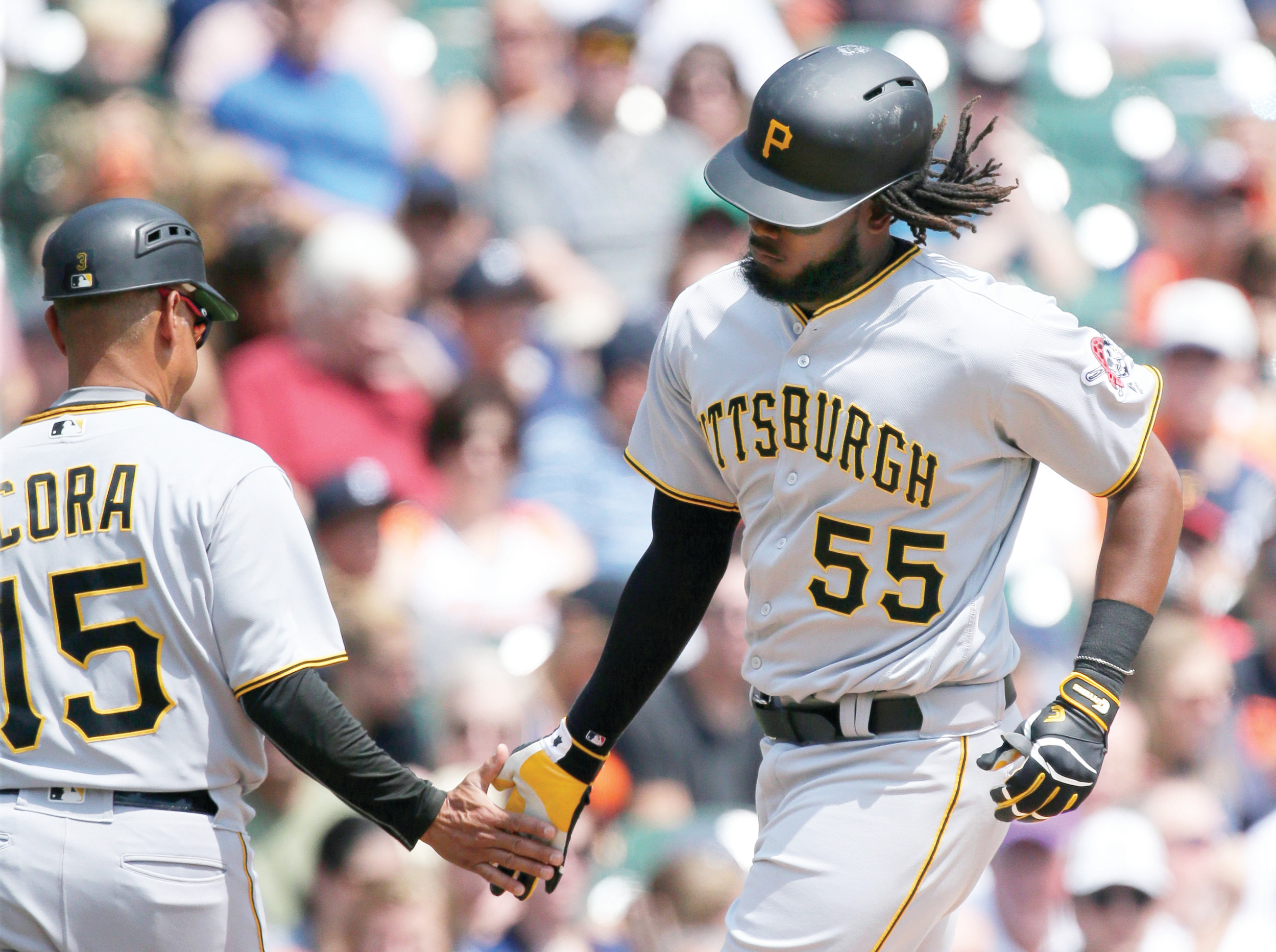 Pittsburgh's Josh Bell (55) is congratulated by third base coach Joey Cora (15) after hitting a 2-run home run against Detroit on Thursday during the Pirates' 7-5 victory in Detroit.