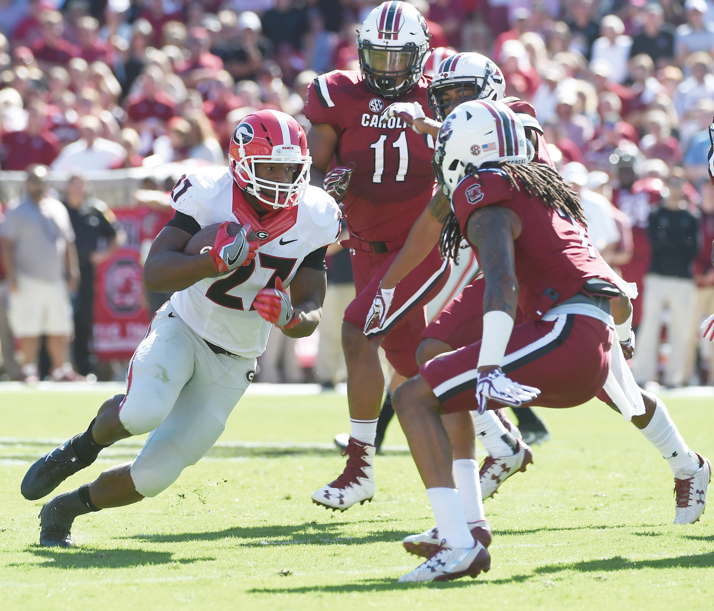 South Carolina's defense was not as stout last season against the likes of Georgia running back Nick Chubb (27) or many other big backs. Head coach Will Muschamp and the Gamecocks are looking to change that this year as well as improving on their own running game as well.