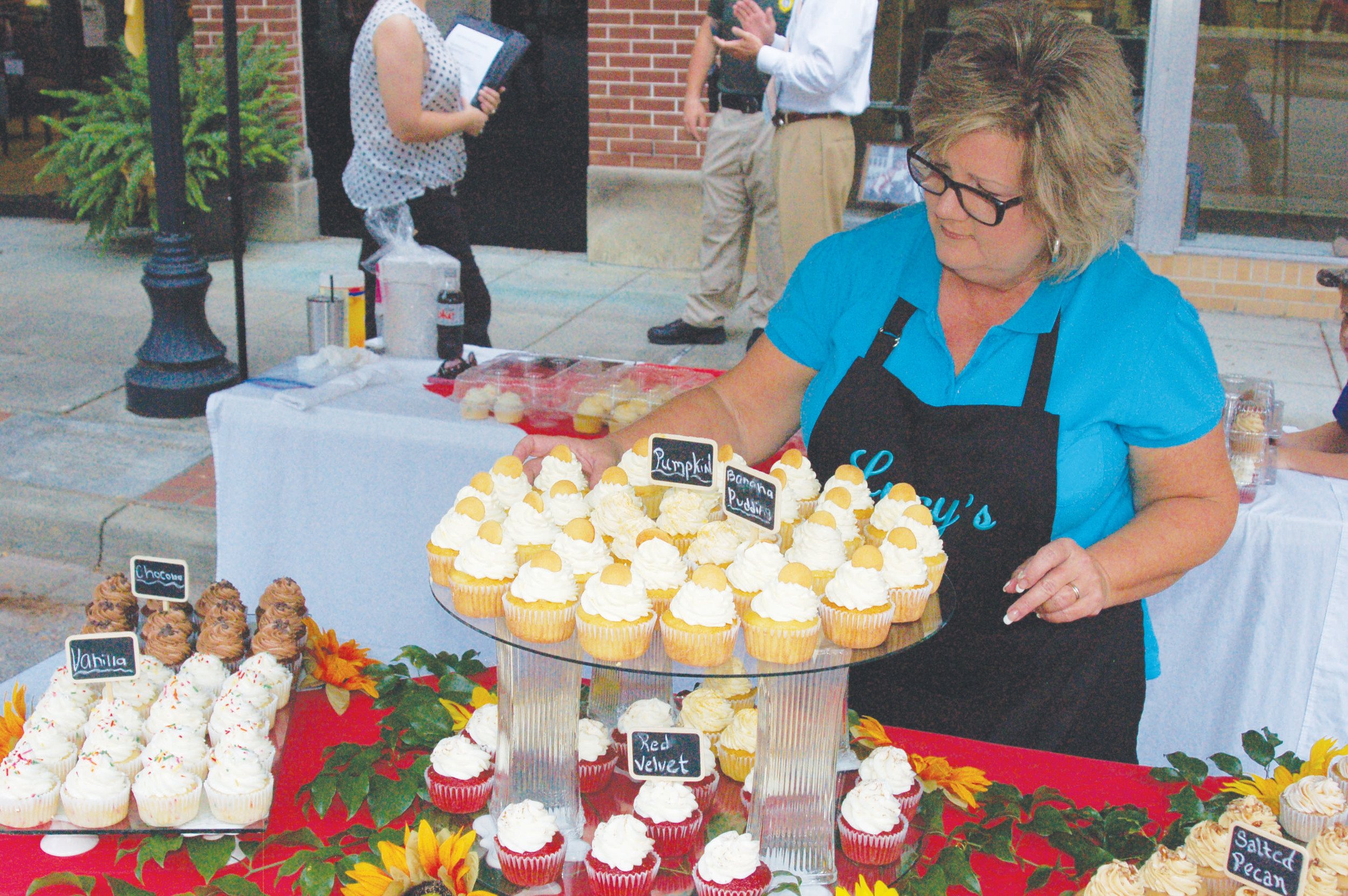 "Jennifer ""Lucy"" Casselman, owner of Lucy's Traditional Southern Bakehouse, displayed her cupcakes at the 2016 Main Street Manning event."