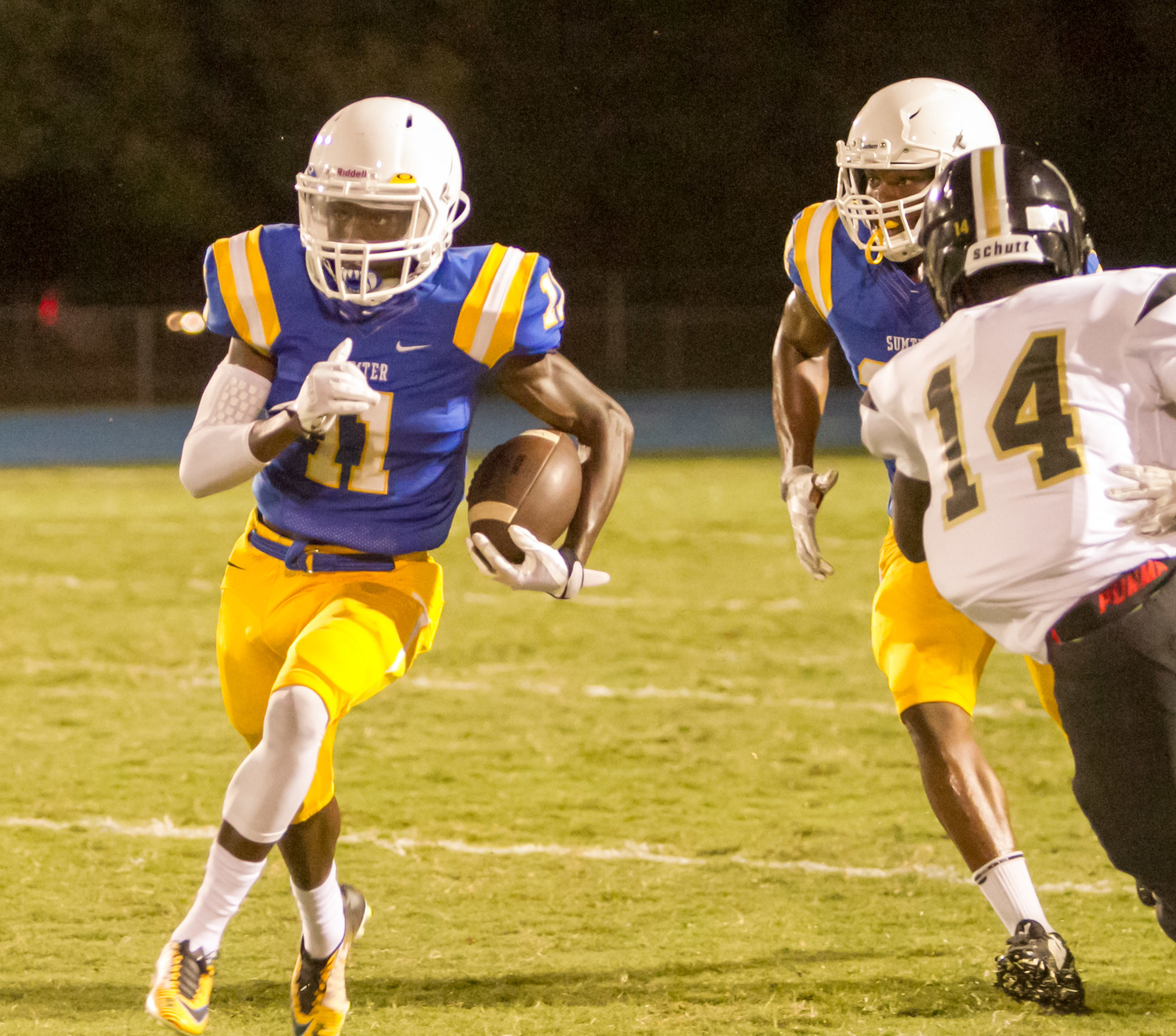 Sumter's Melvin Lundy (11) returns the opening kickoff 80 yards for a touchdown during the Gamecocks' 14-14 tie with Manning High School on Friday during the Sumter Sertoma Football Jamboree at Sumter Memorial Stadium's Freddie Solomon Field.