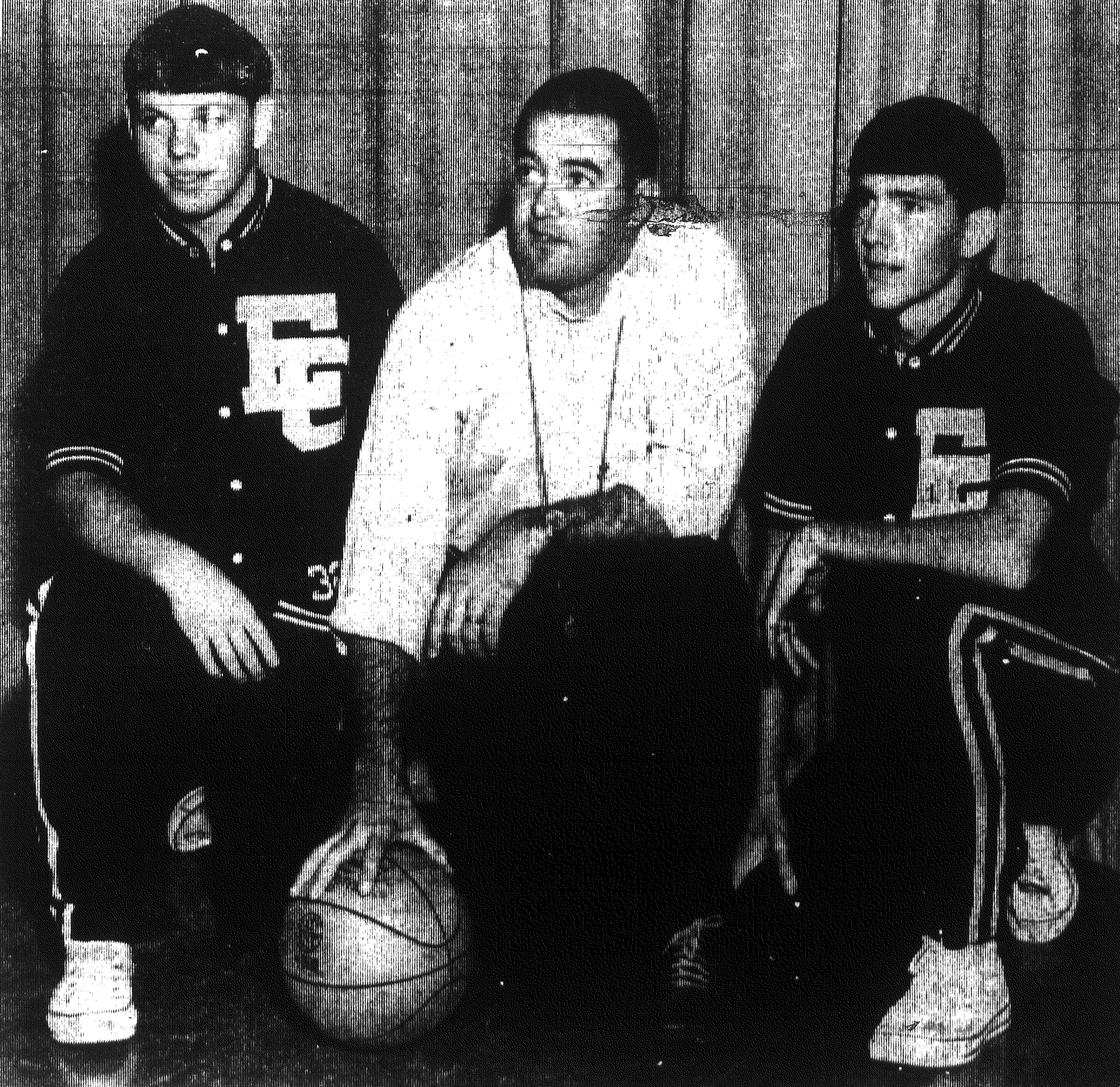 1967 - East Clarendon's Donald Thomas, left, and last season's high scorer Pete Atkinson, right, along with head basketball coach Maxie Knowlton, watch the rest of the team work out. The Wolverines open the 1967-68 basketball season at home Tuesday night against Hebron.