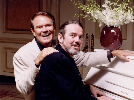 Glen Campbell, left, is seen with Jimmy Webb in 2005. Webb wrote many of Campbell's biggest hits.