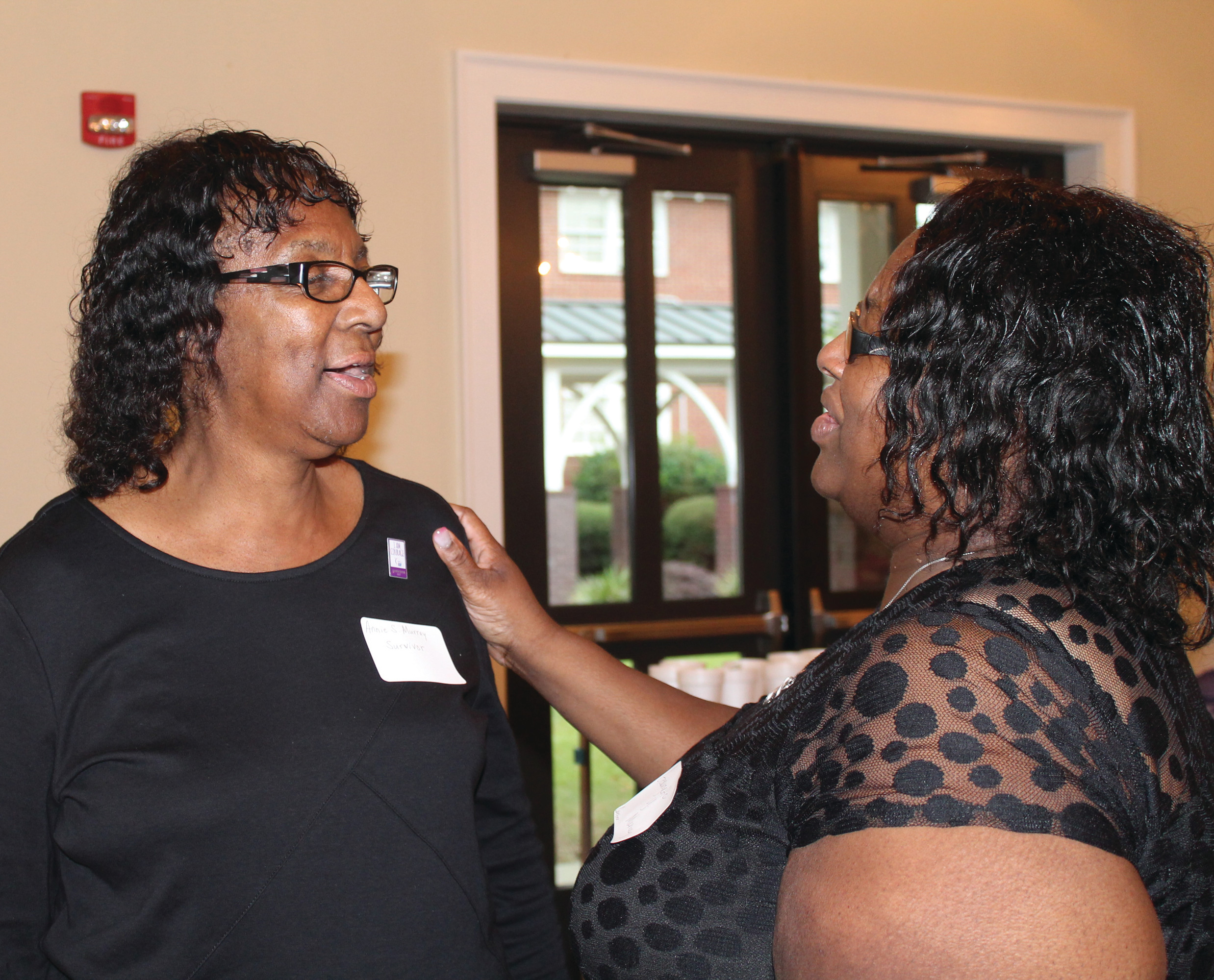 Annie Murray, a cancer survivor, and her daughter, Georgette, are all smiles following the Survivor Pinning Ceremony at the Celebrate Life Survivor Social held Aug. 31 at  Manning United Methodist Church. The Murrays and more than 100 caregivers and survivors took part in the Survivor Pinning Ceremony.