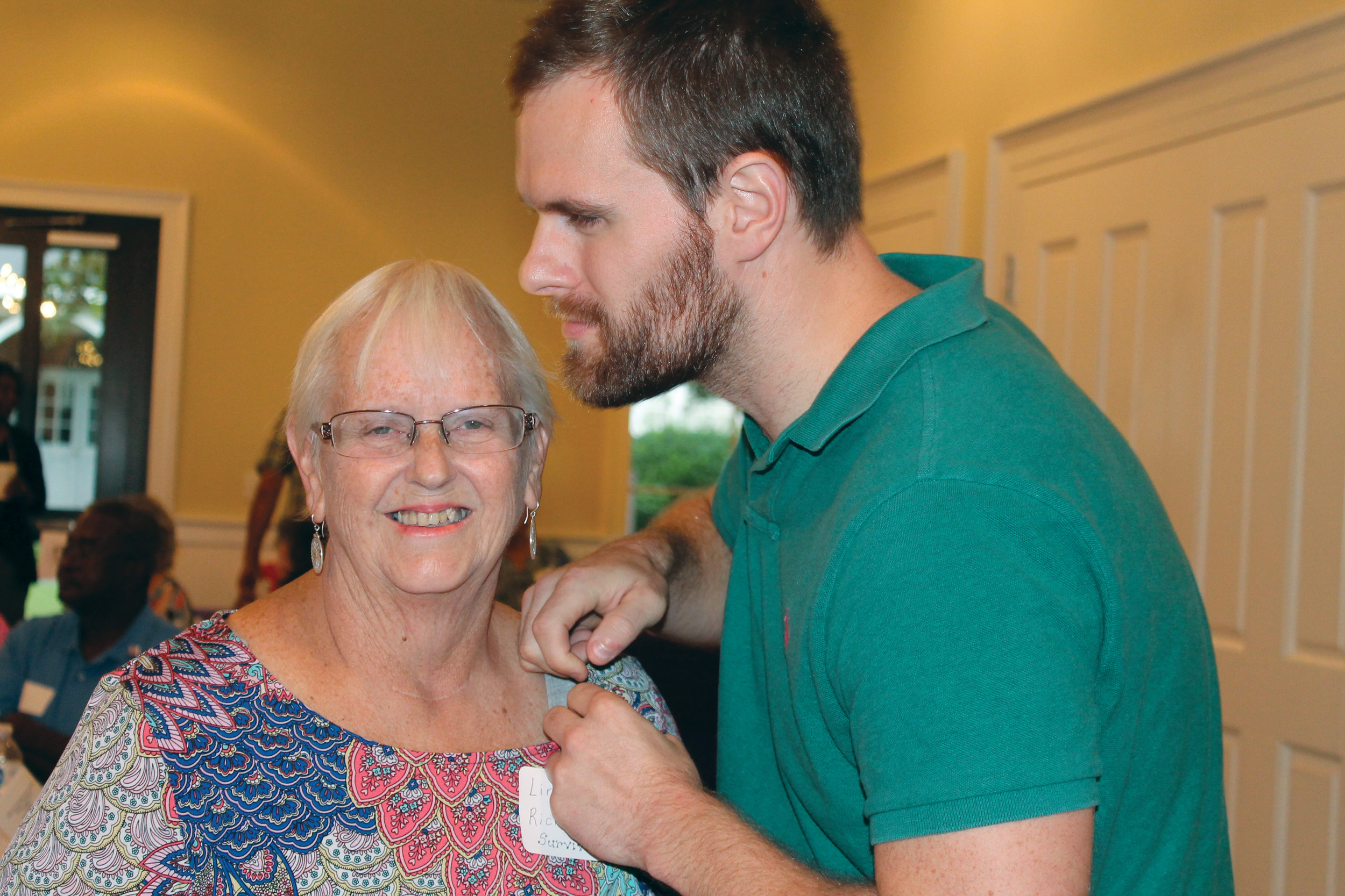 Linda Richburg, a cancer survivor, and her son, Dave, participated in the Survivor Pinning Ceremony at the Celebrate Life Survivor Social held Aug. 31 at Manning United Methodist Church. More than 100 caregivers and guests attended the social that was sponsored by the 2018 Clarendon County Relay Committee and American Cancer Society.