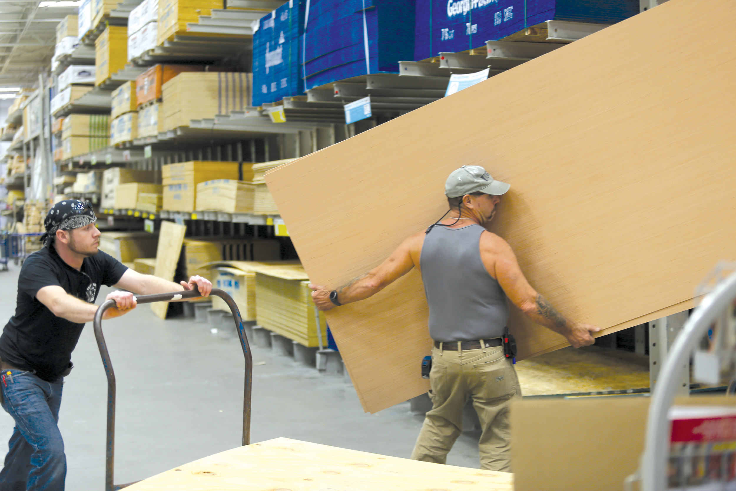 Customers select plywood at Lowe's on Thursday in preparation for Hurricane Irma.