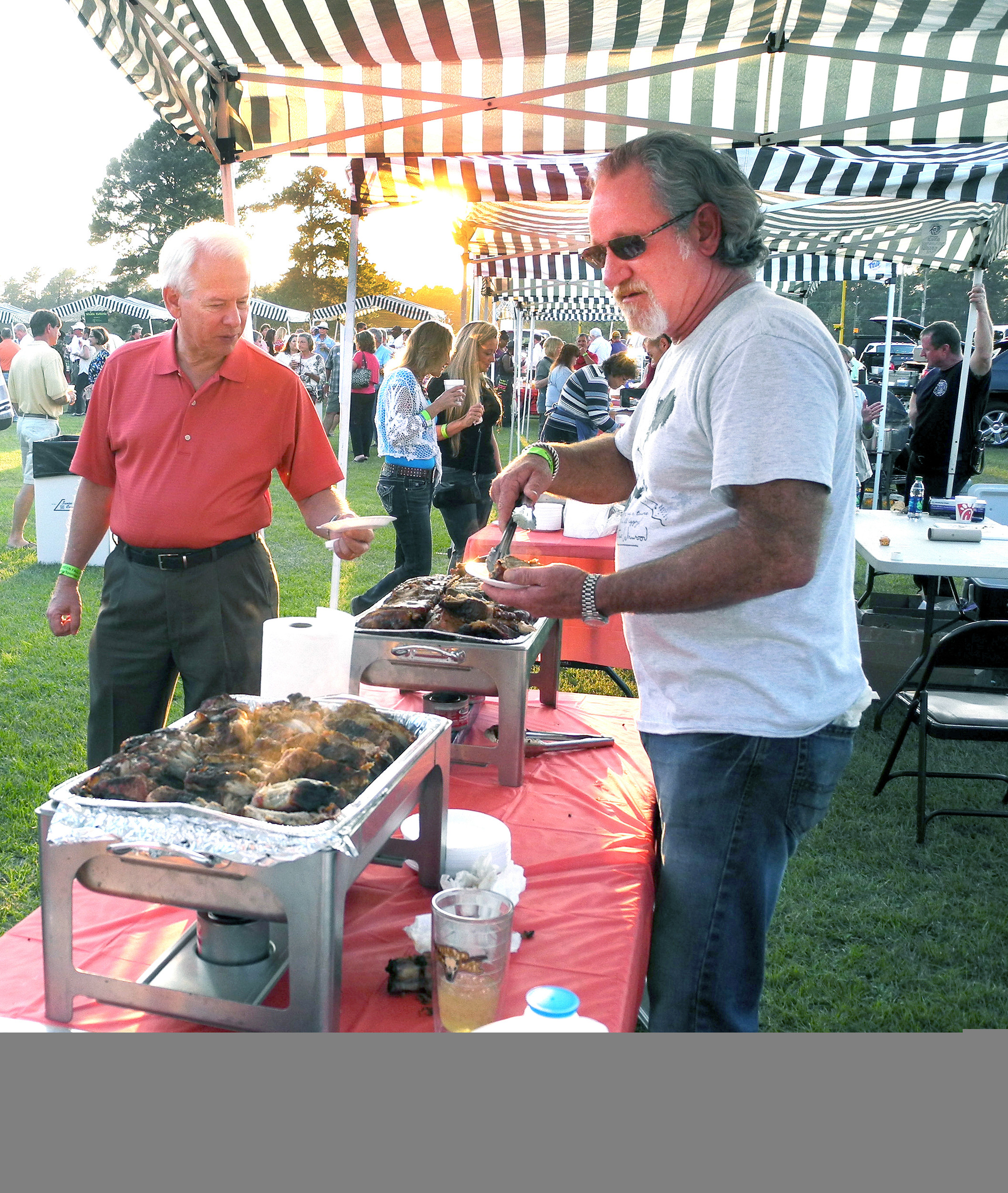 Ricky McLeod serves up some baby back ribs to Talmadge Tobias at a past Fall Feast. McLeod's restaurant, Willie Sue's, will be serving some of its specialties at this year's Fall Feast on Sept. 21.