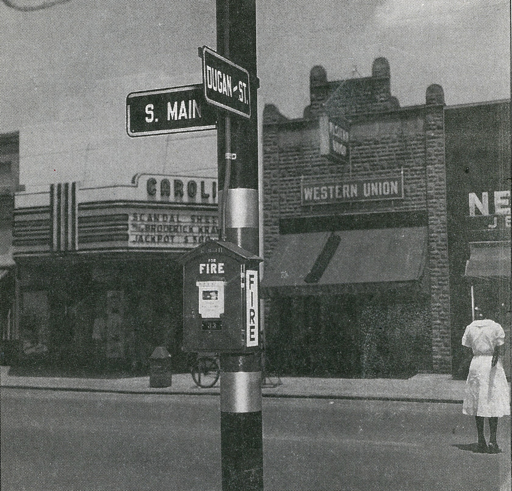 This photo, from a collection belonging to the late former City Manager J.A. Raffield, was thought to be taken in 1949 or 1950. It shows a new fire alarm box on the corner of Dugan and South Main streets. On the right is Neiman's Jewelers, and to the left is Western Union Telegraph Co. In the middle is the Carolina Theatre that was owned and operated by Isadore Denemark and J. Lawrence Goldsmith.