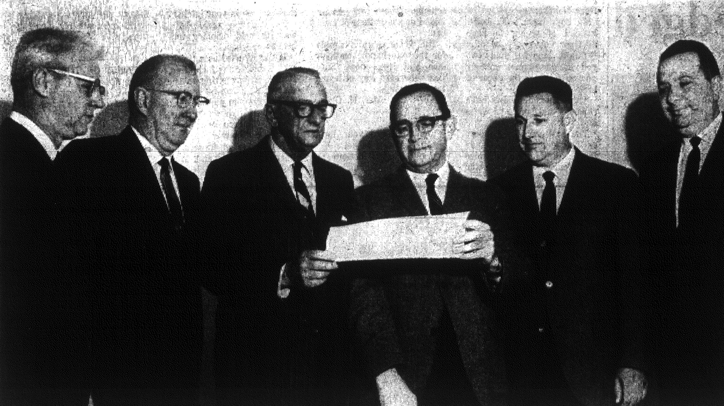 1967 - Division chairmen of the Wilson Hall campaign to raise $500,000 for a permanent campus for the private school look over plans. From left, they are Clint Brogdon, D.B. James, S.A. Harvin, J.E. Eldridge, Edward Gibson and Ramon Schwartz.