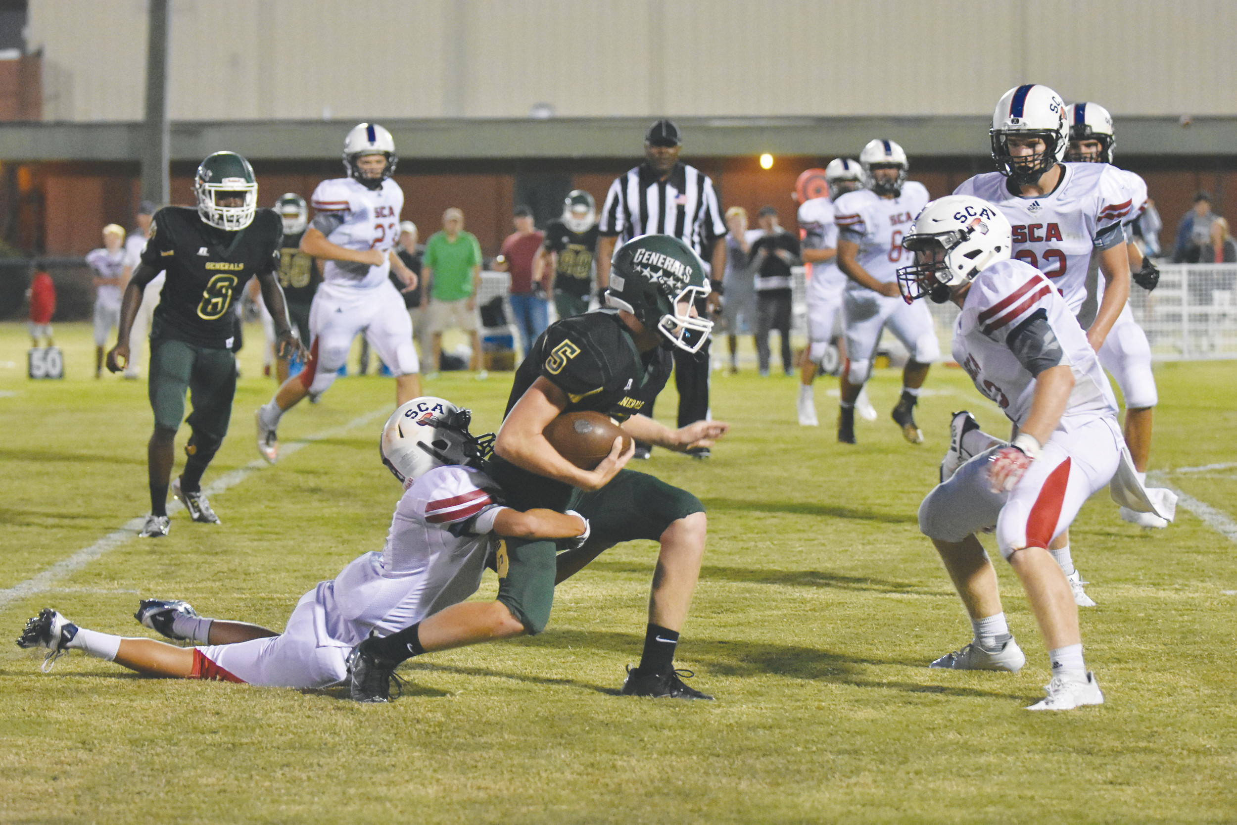 Thomas Sumter Academy's Mason Warren (5) is wrapped up during the Generals' 50-34 loss to Spartanburg Christian on Friday at General Field in Dalzell.