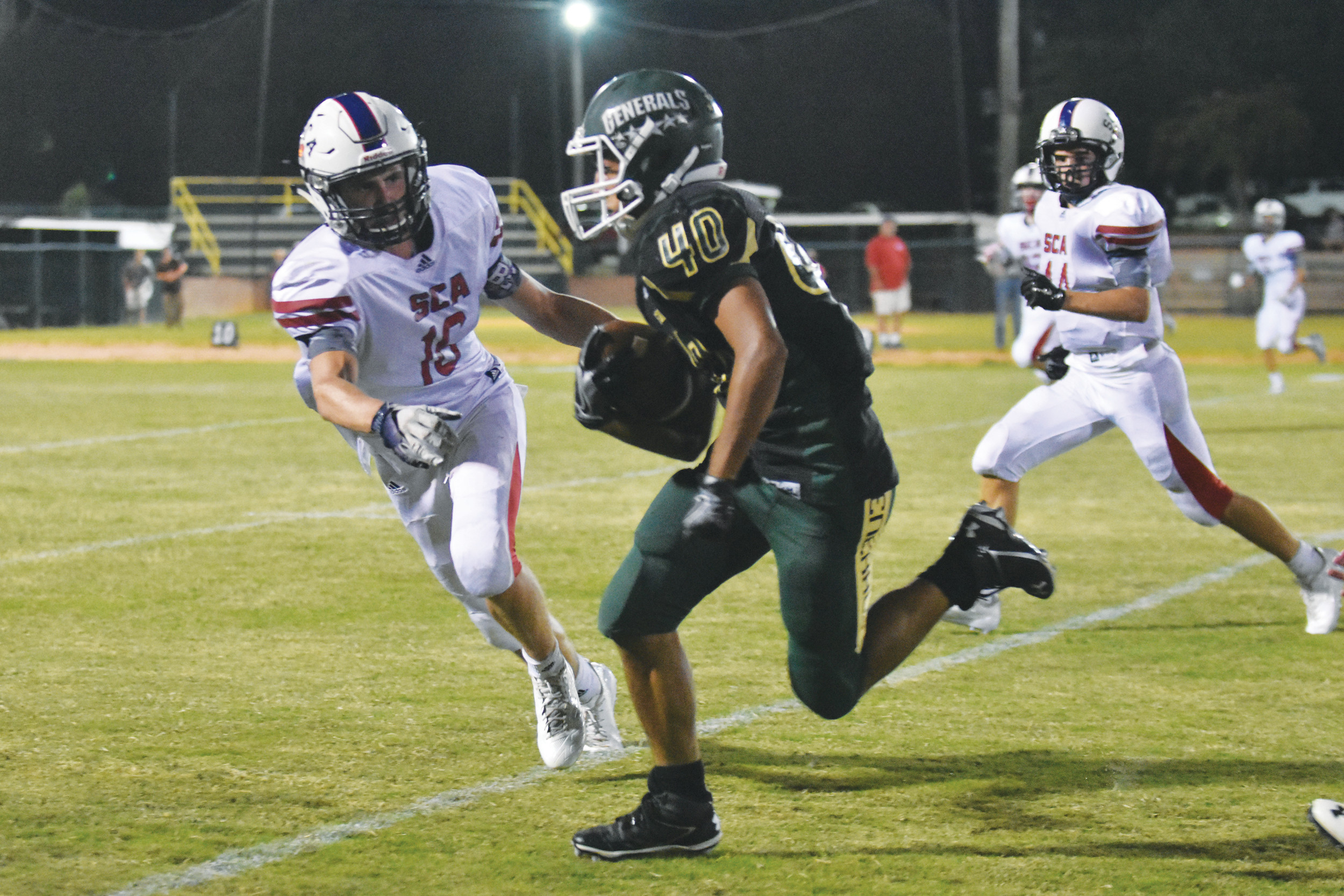 Thomas Sumter Academy's Richard Hutley (40) tries to elude an oncoming defender during the Generals' 50-34 loss to Spartanburg Christian on Friday at General Field in Dalzell.