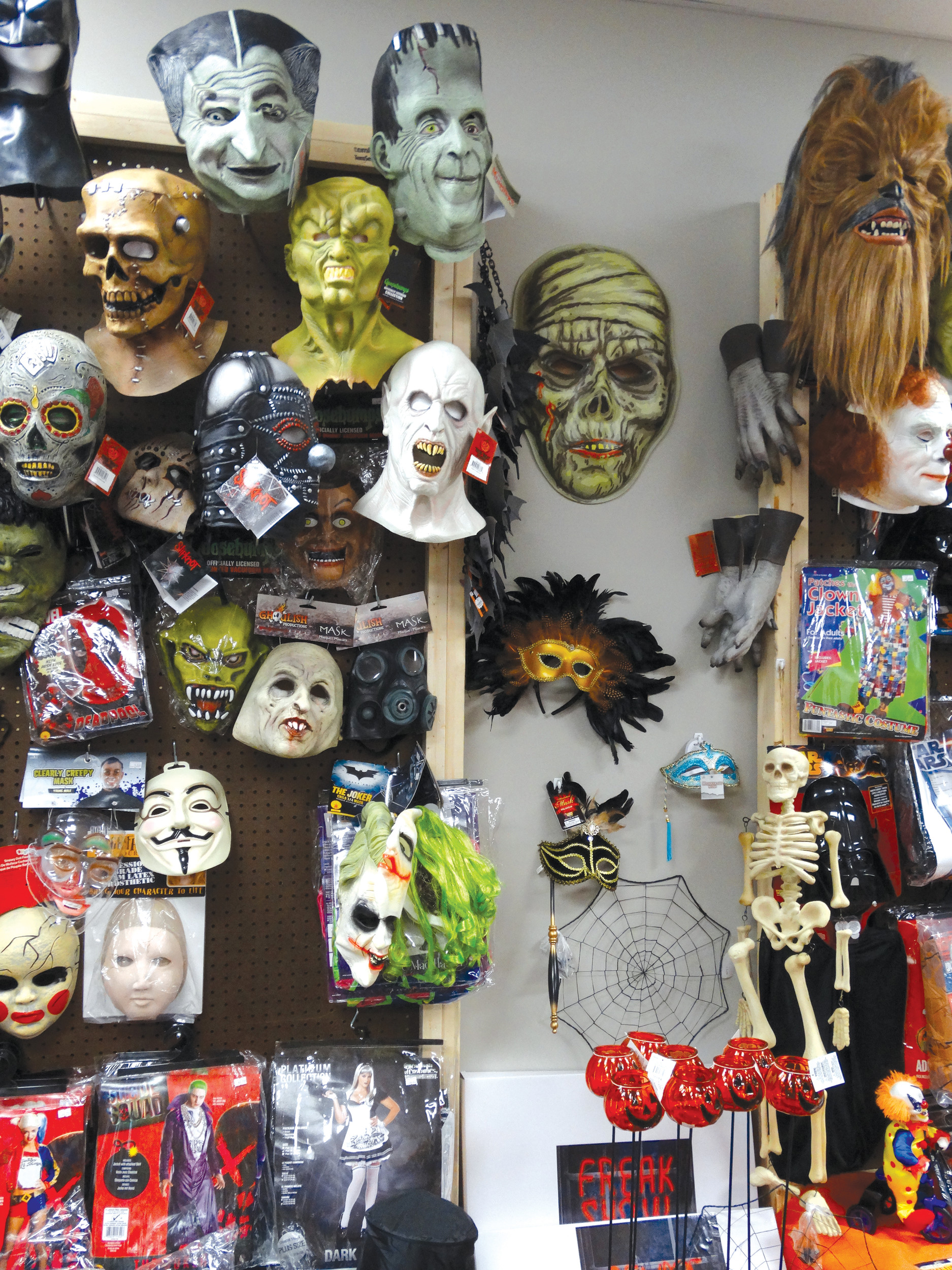Dozens of masks to choose from line the walls of M&M's Lil Shop o' Horrors.
