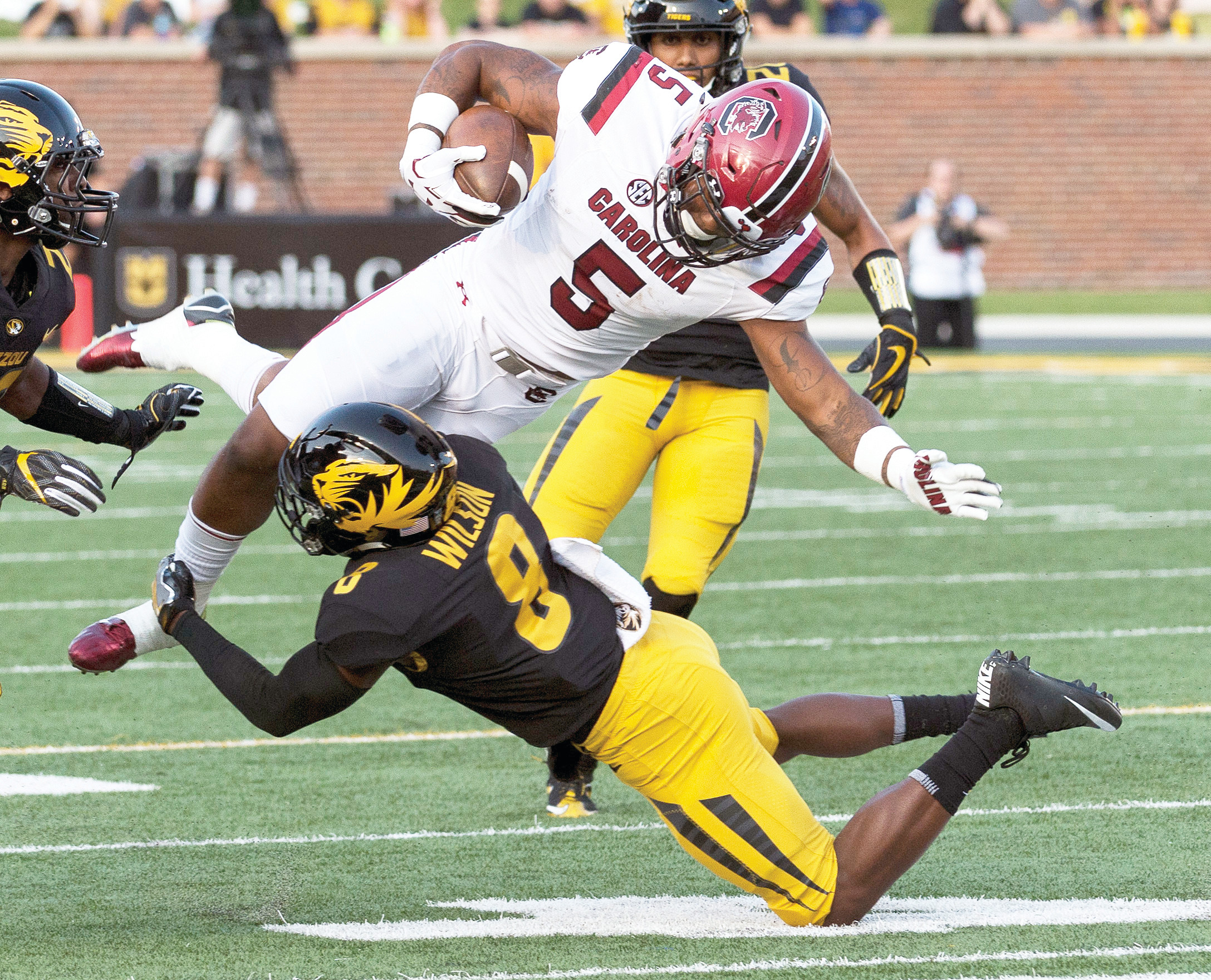 South Carolina running back Rico Dowdle (5) is tackled by Missouri's Thomas Wilson (8) during the Gamecocks' 31-13 victory on Saturday in Columbia, Missouri.