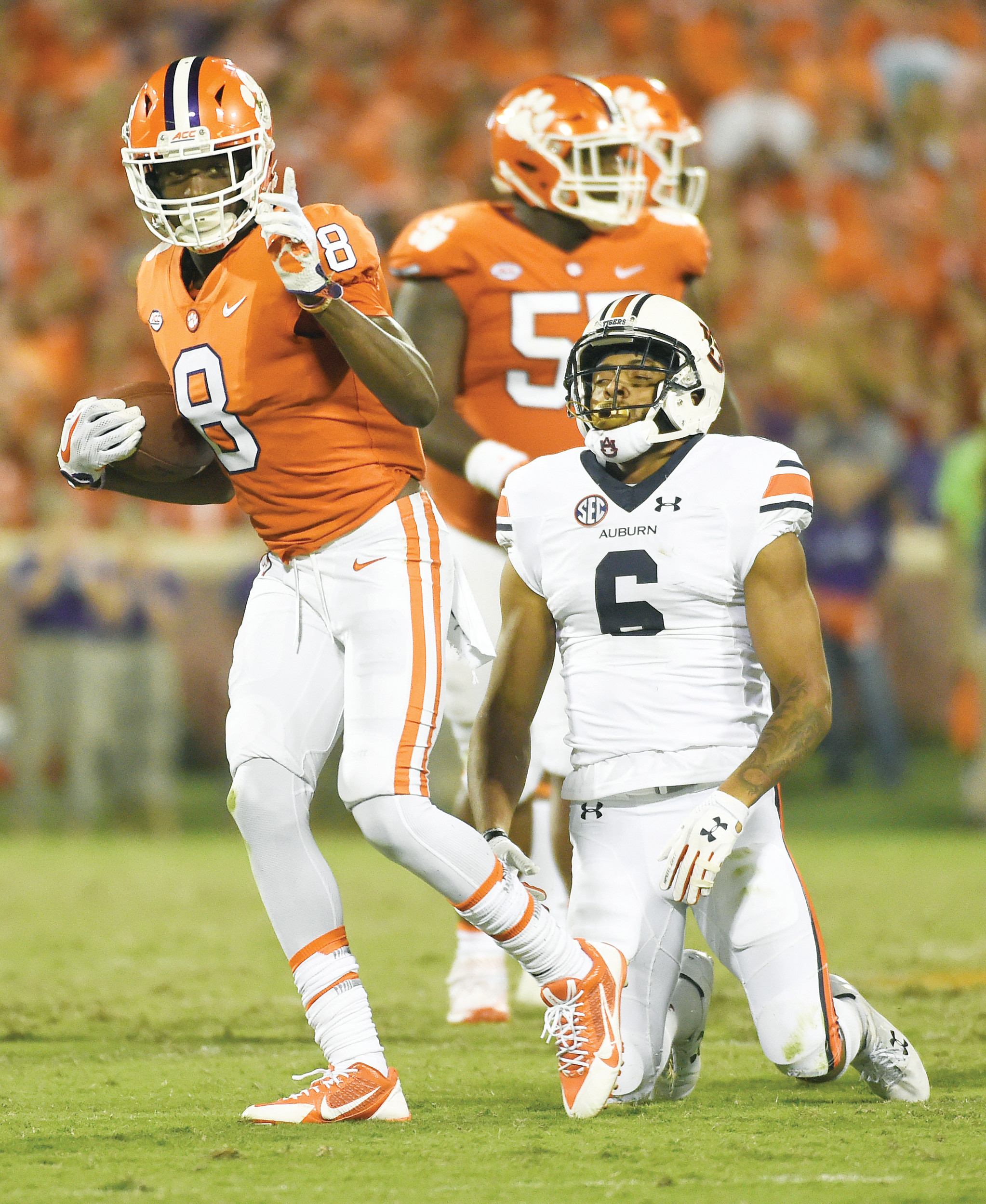 Clemson wide receiver Deon Cain (8) gestures after making a catch as Auburn defensive back Carlton Davis (6) reacts during Clemson's 14-6 victory on Saturday at Memorial Stadium in Clemson.