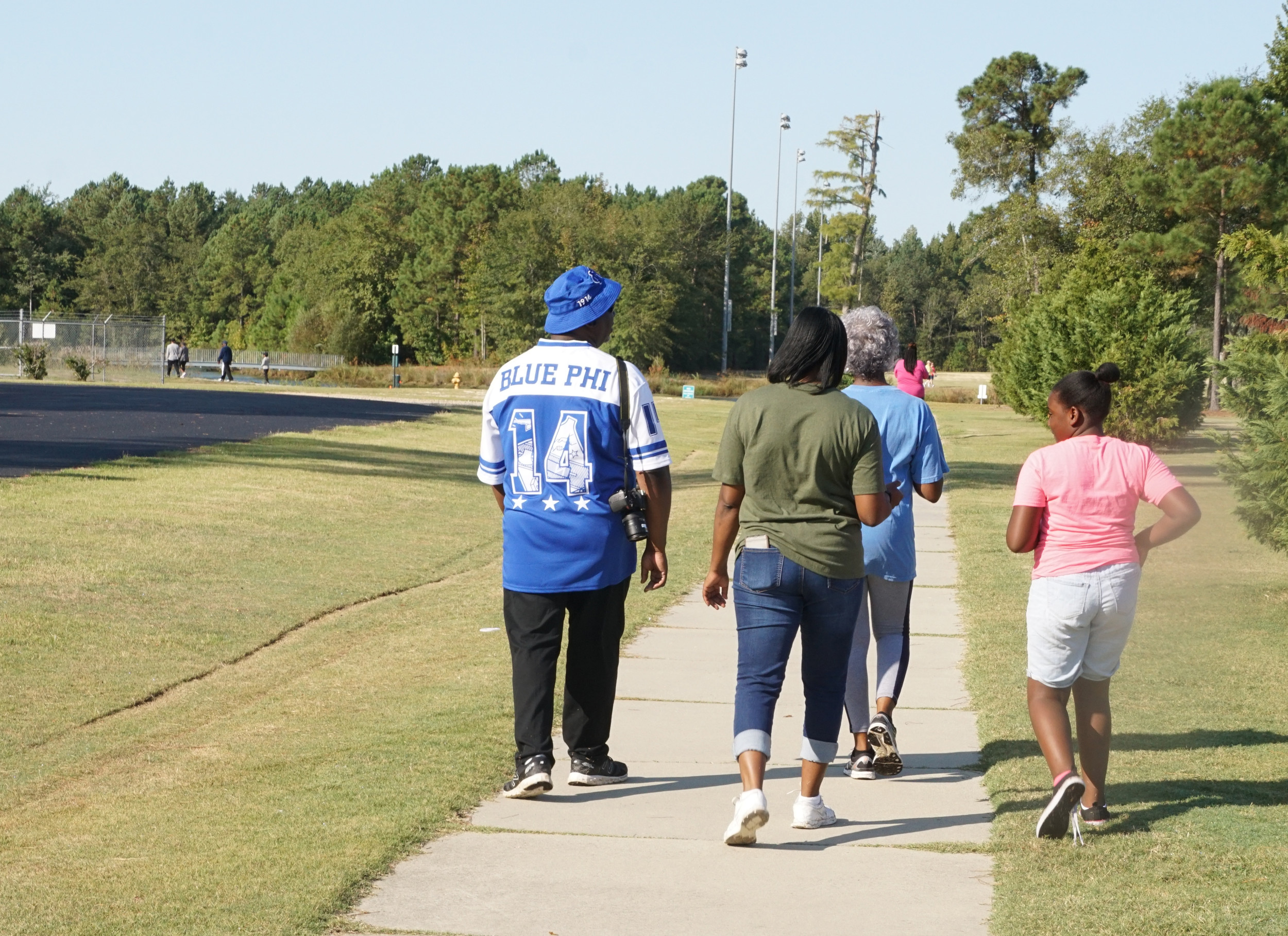 JIM HILLEY /  THE SUMTER ITEMMonica Jackson, right, walks with her grandparents at the Grandparents Day Walk sponsored by Sumter County Active Lifestyles at Patriot Park on Saturday.