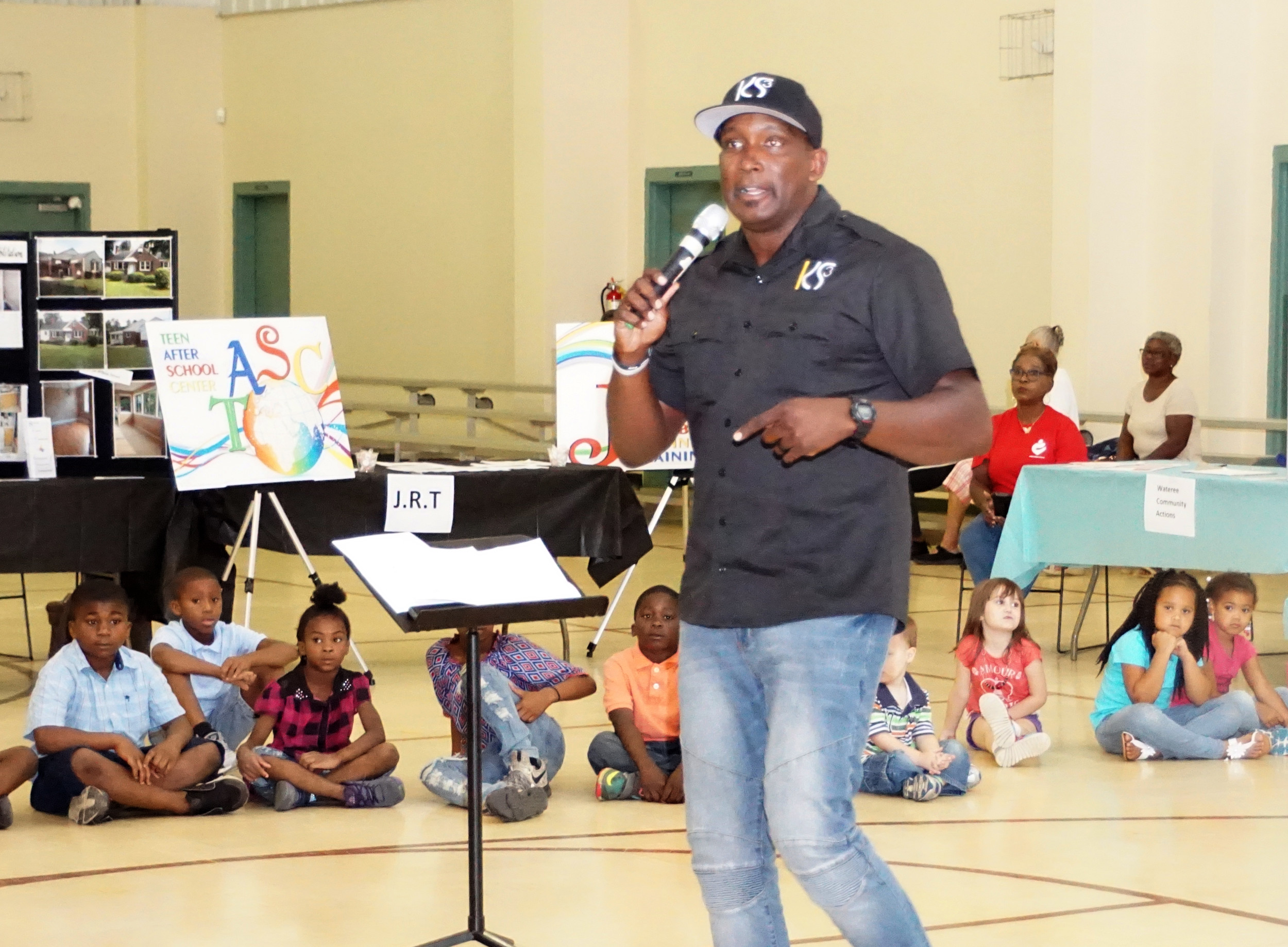 Kelly Simmons III, a motivational speaker from Columbia and a father, talks with attendees about the need to take responsibility as a parent at the Midland Fatherhood Coalition's Family Day at South Hope Center in Sumter.