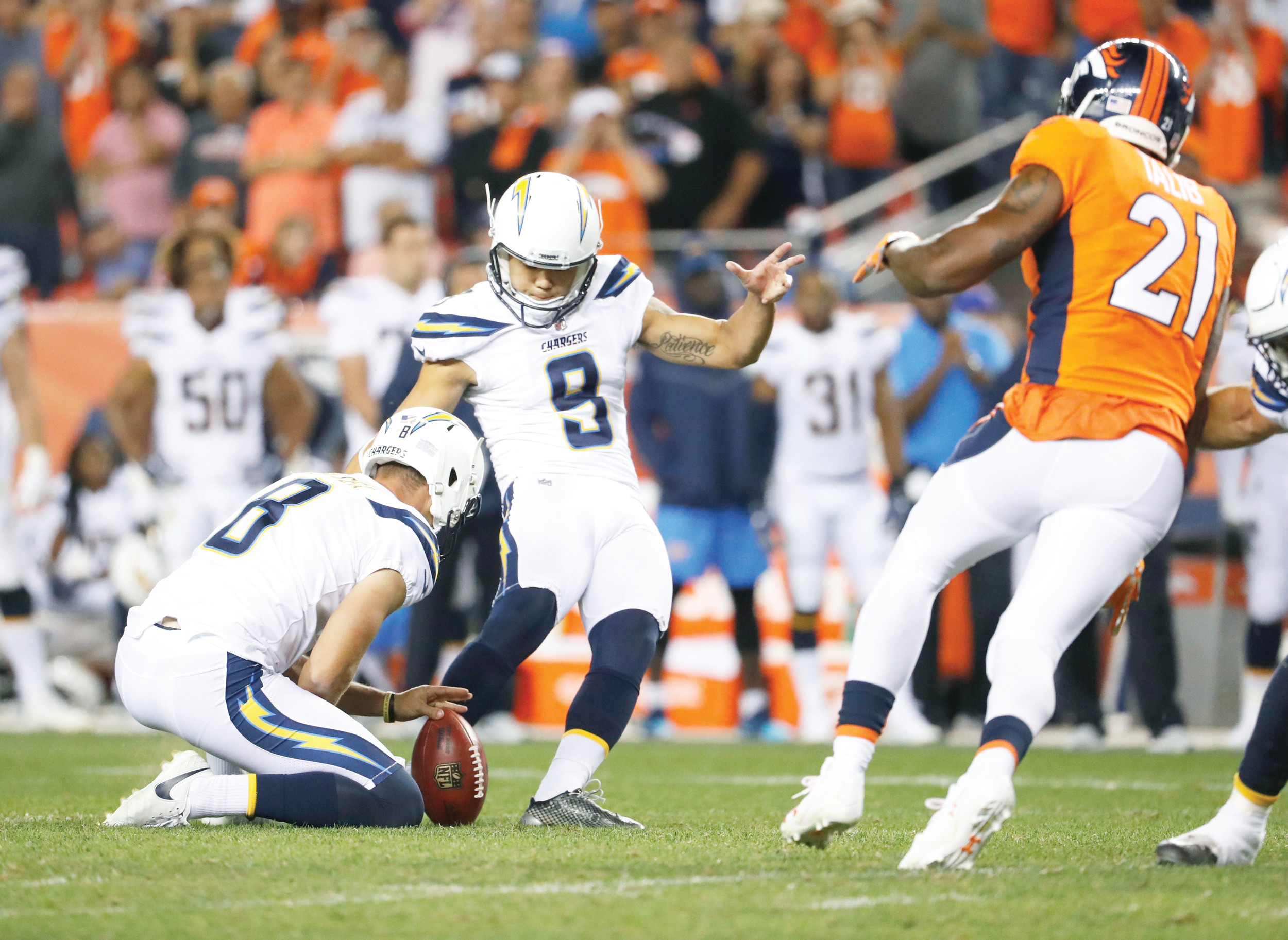 Los Angeles Chargers placekicker Younghoe Koo (9) attempts a game-tying field goal attempt against Denver on Monday in Denver. The kick was blocked and the Broncos won 24-21.