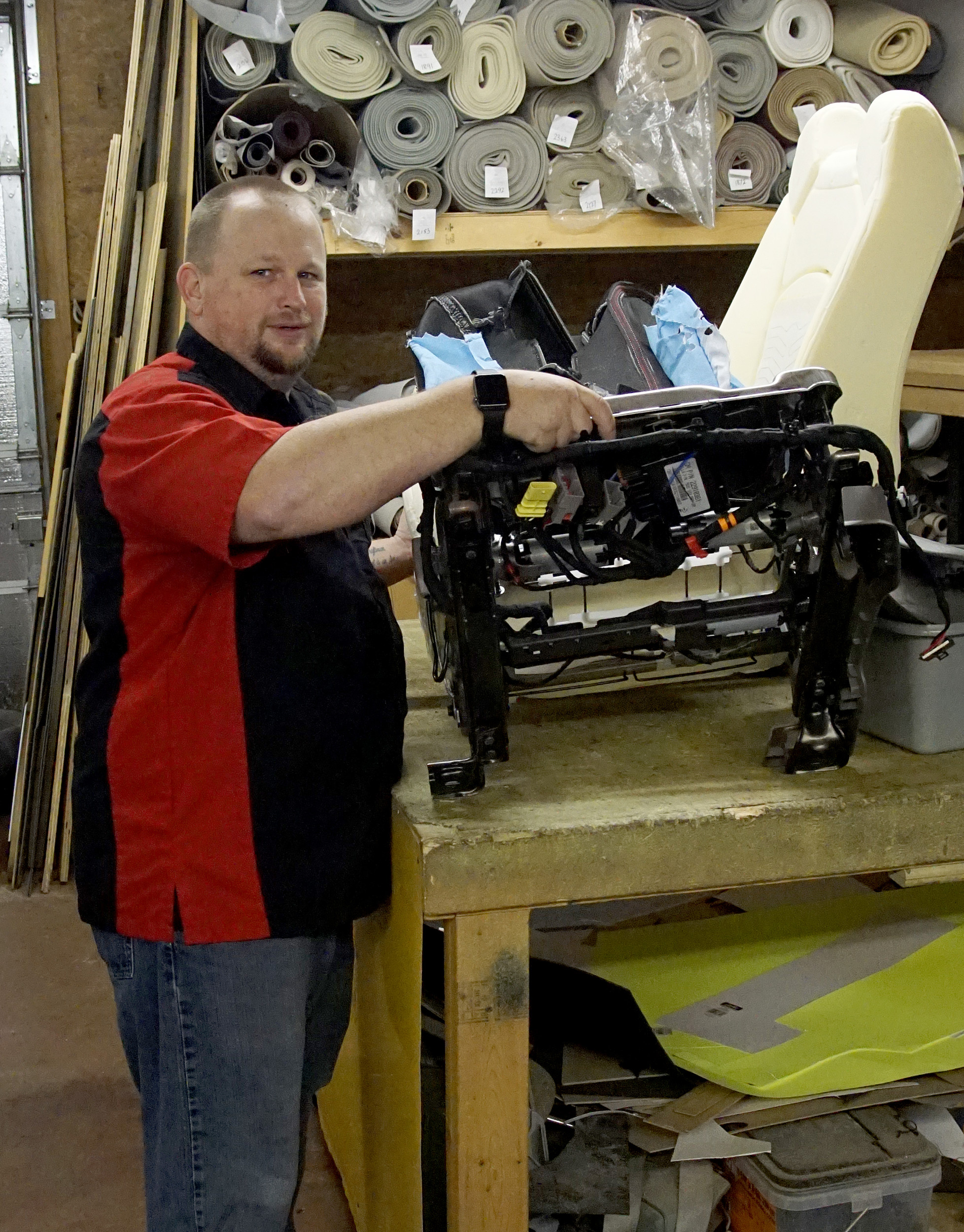 Chuck Bench, owner of Auto Pro Interiors in Dalzell, shows the components found underneath a modern automobile seat.