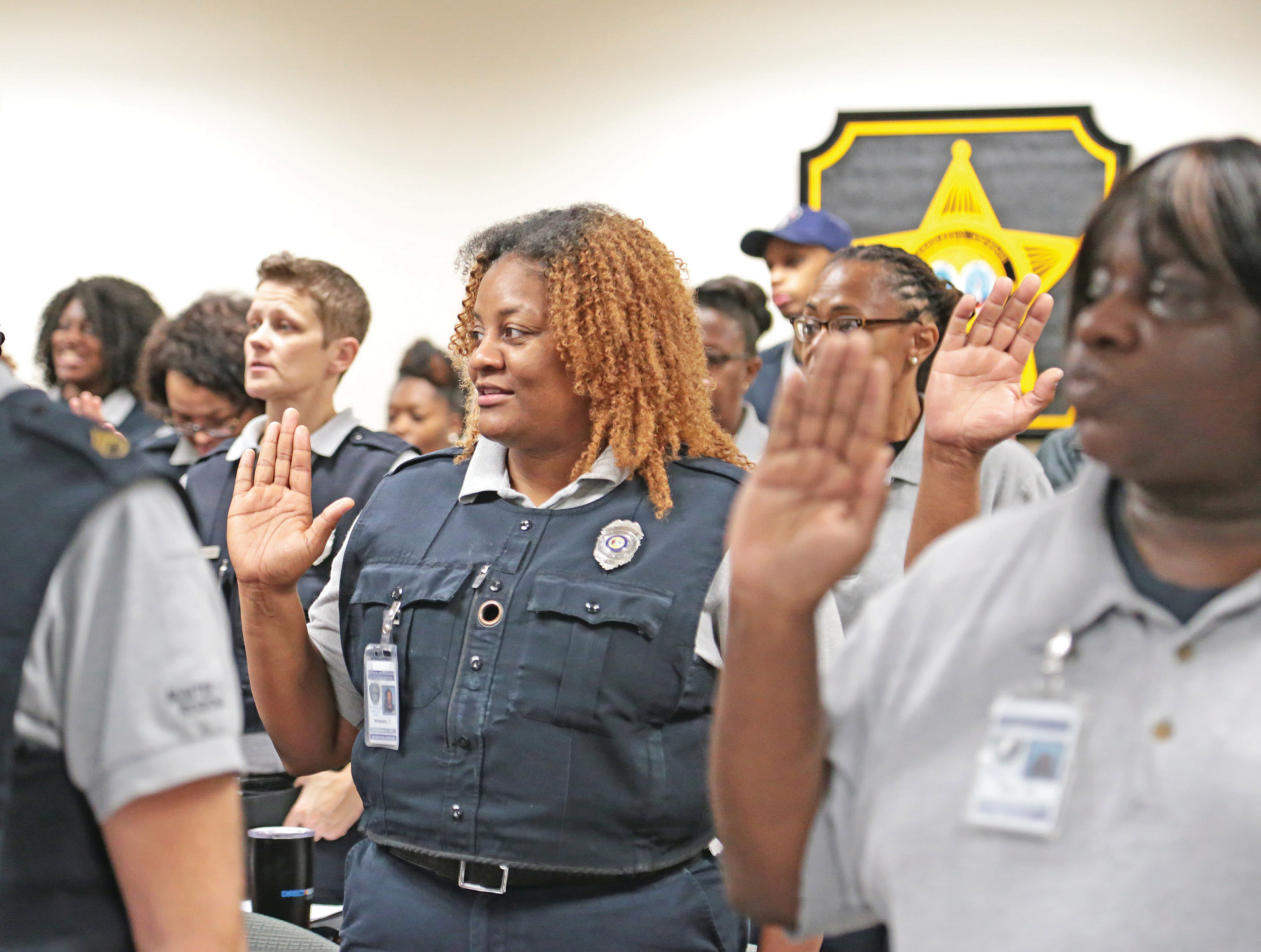 Corrections officers with Sumter-Lee Regional Detention Center recite their oath as they are sworn in as employees of Sumter County Sheriff's Office on Wednesday morning. Sumter County Council approved an ordinance giving Sheriff Anthony Dennis the authority to manage the detention center during its meeting on Tuesday.