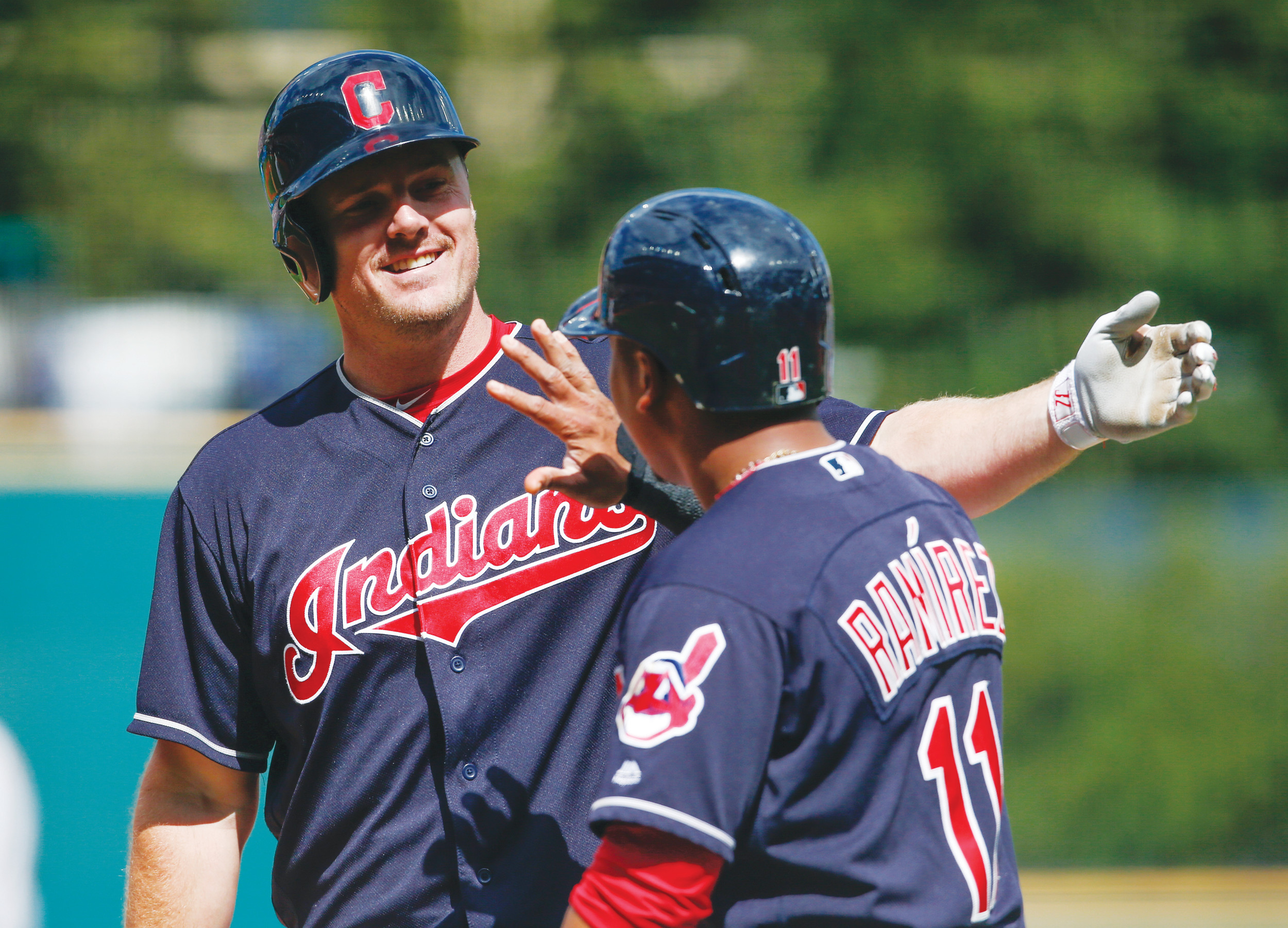 Cleveland's Jay Bruce celebrates with Jose Ramirez (11) after hitting a 3-run home run during the Indians' 5-3 victory over Detroit on Wednesday in Cleveland.