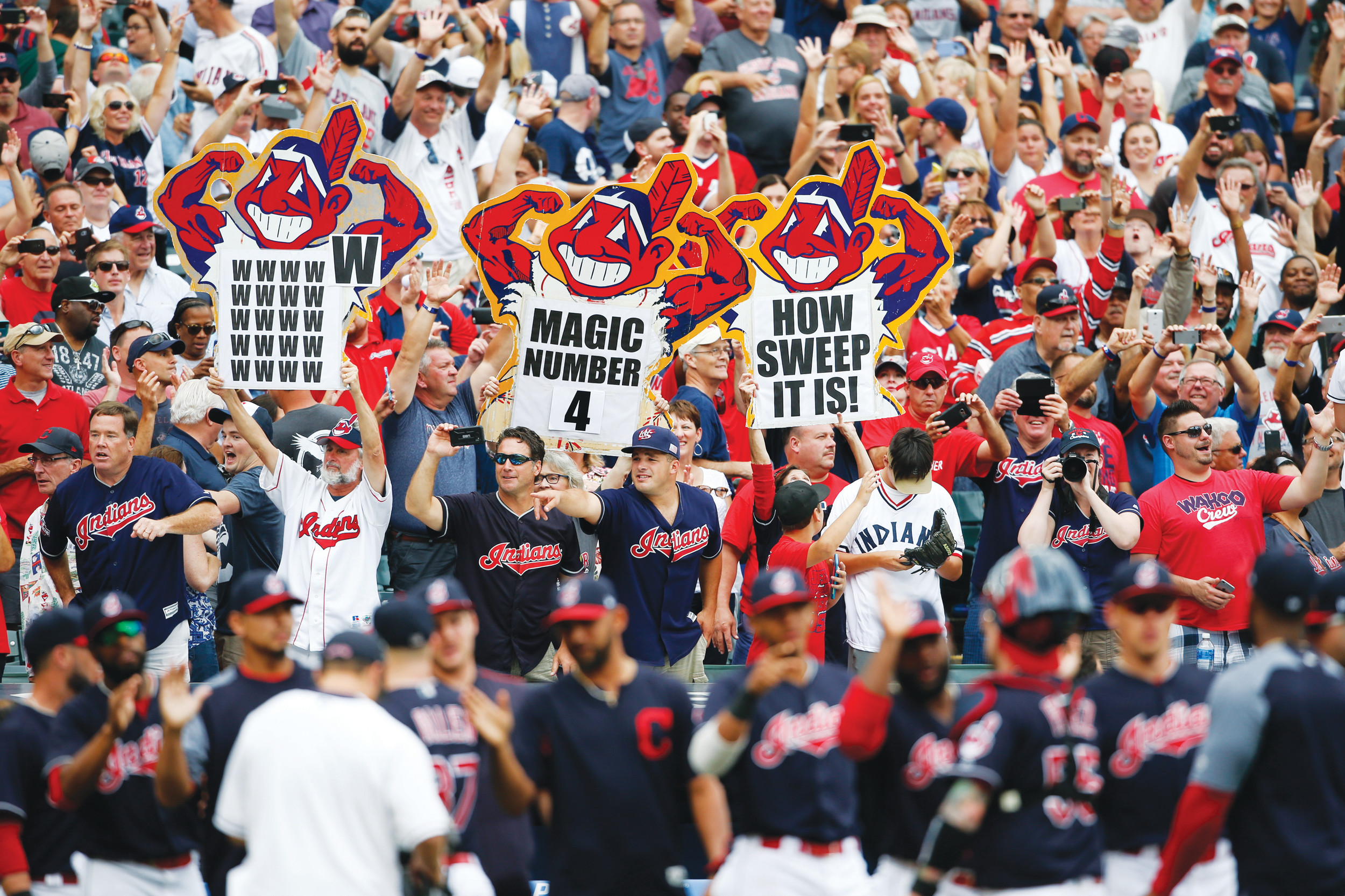 Cleveland Indians fans celebrate a 5-3 victory over the Detroit Tigers in a game Wednesday in Cleveland. The Indians set the American League record with 21 consecutive wins.