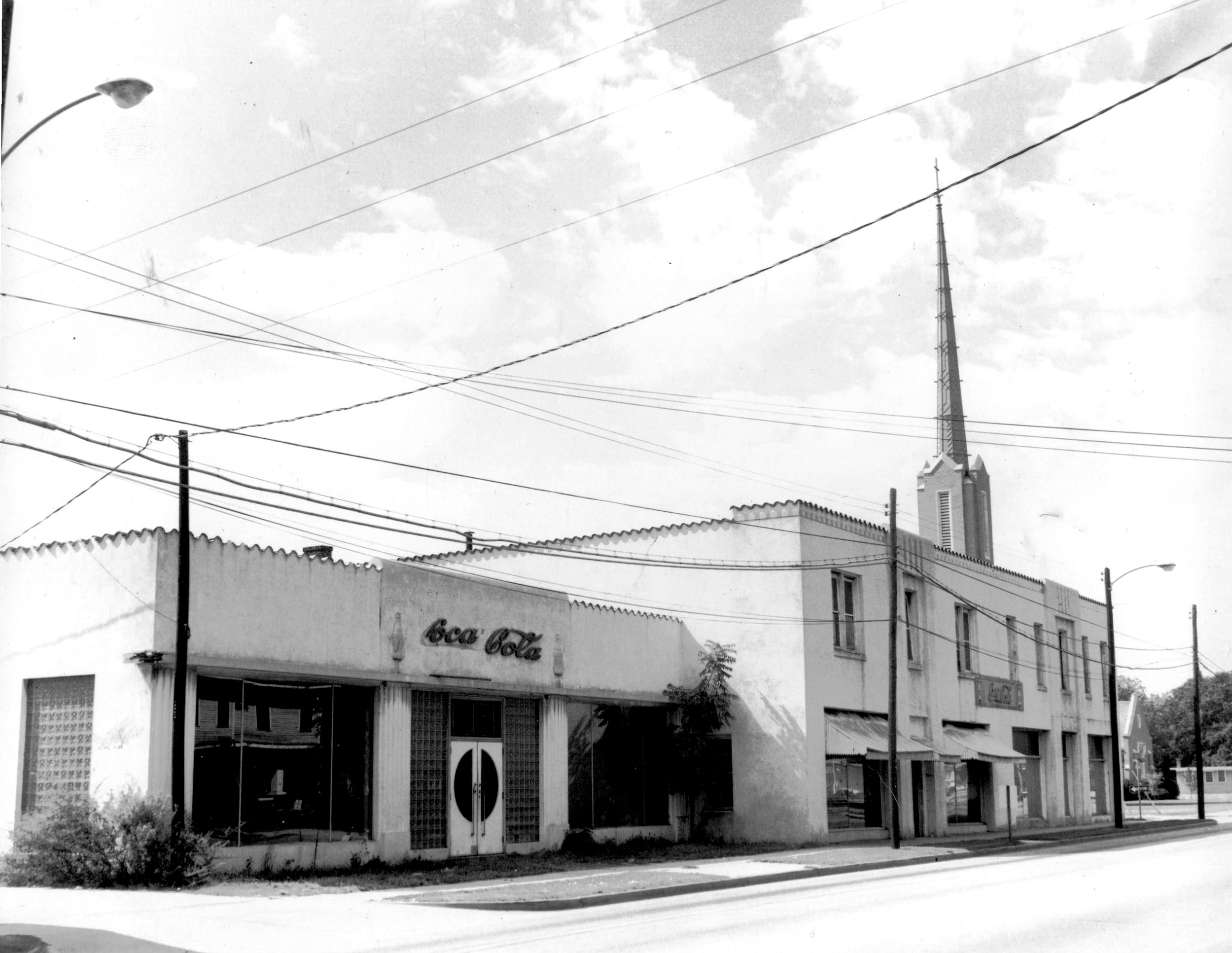 Coca-Cola bottling plant on West Liberty Street, across Council Street from Trinity United Methodist Church, is shown. The business later moved to a new building at the intersection of U.S. 76 and 378.