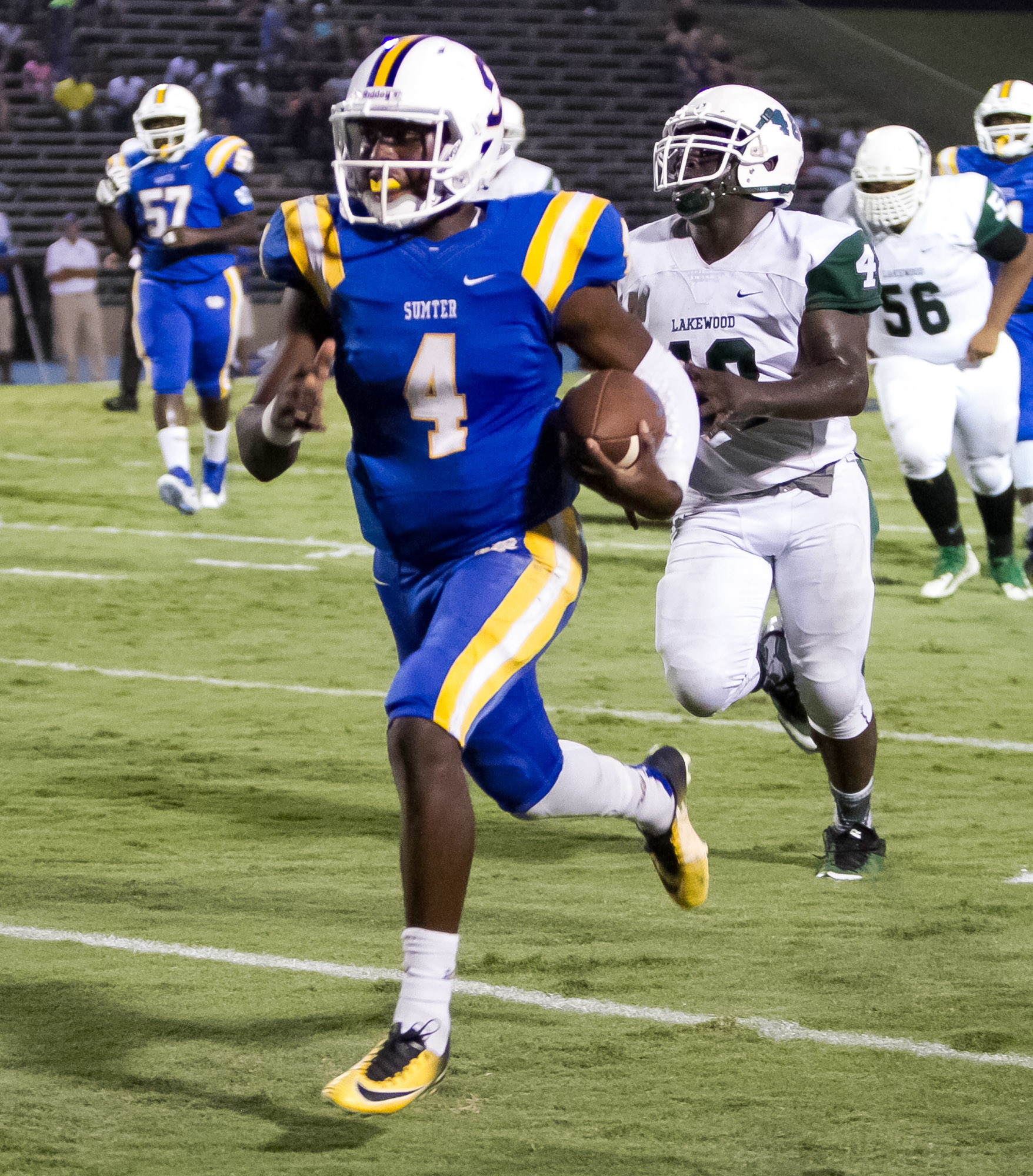 Sumter quarterback Zykiem Jackson (4) outruns Lakewood's Greg Brunson (4) for a big gain during the Gamecocks' 41-29 victory on Friday at Memorial Stadium.