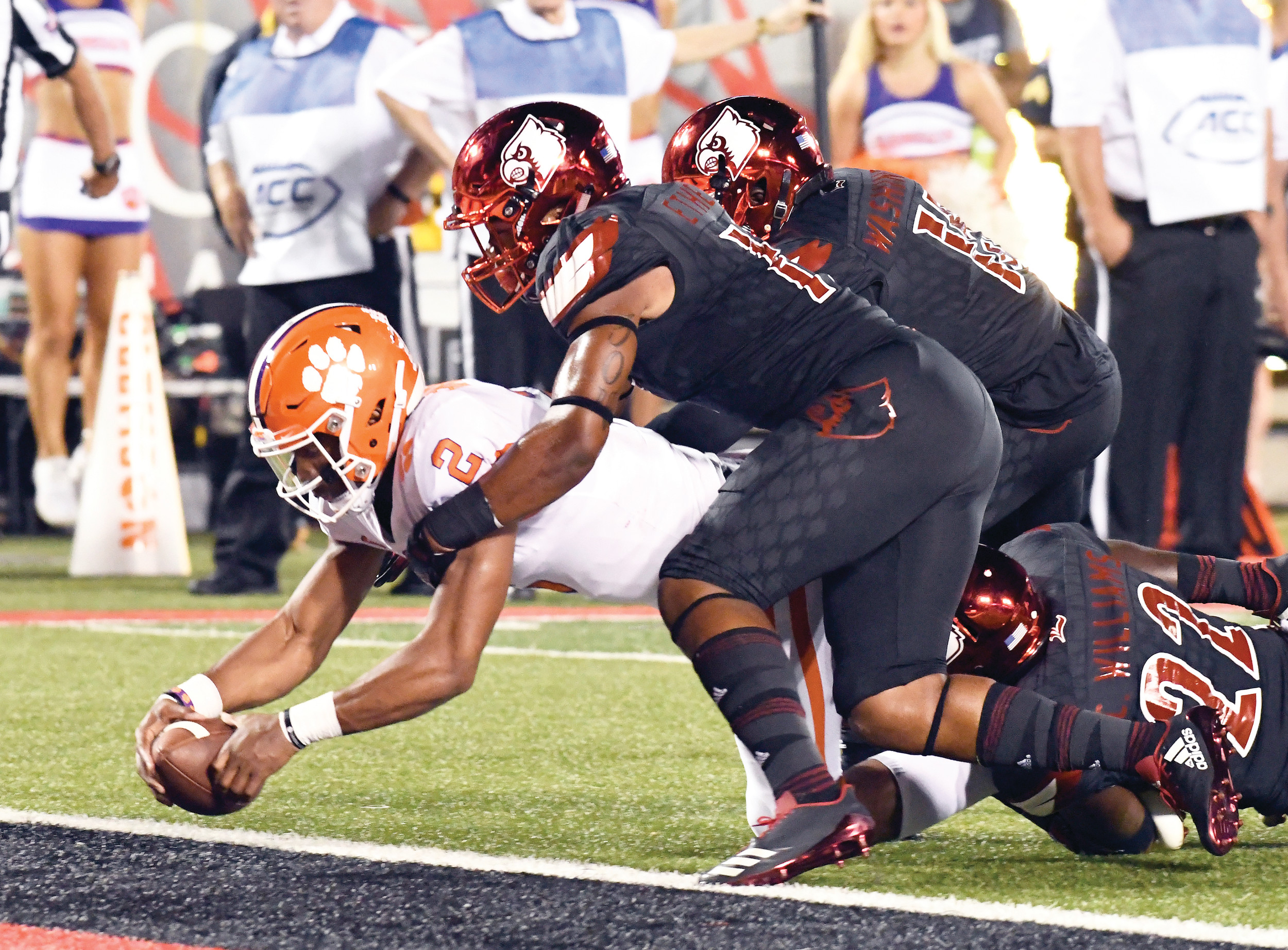 Clemson quarterback Kelly Bryant (2) is brought down by Louisville's Dorian Etheridge, front right, and Trumaine Washington (15) as he crosses the goal line during the Tigers' 47-21 victory on Saturday in Louisville, Kentucky.