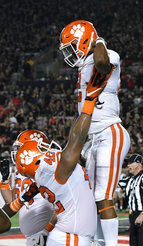 THE ASSOCIATED PRESSClemson linebacker Jarvis Magwood (46) lifts up quarterback Kelly Bryant (2) following a Bryant touchdown during the Tigers' 47-21 victory over Louisville on Saturday in Louisville, Kentucky. The Tigers moved up to No. 2 in The Associated Press poll.