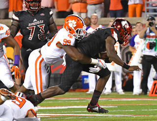 THE ASSOCIATED PRESSClemson defensive end Clelin Ferrell brings down Louisville's Heisman Trophy quarterback Lamar Jackson in the Tigers' 47-21 victory on Saturday in Louisville, Kentucky. Clemson moved up to No. 2 in The Associated Press poll.