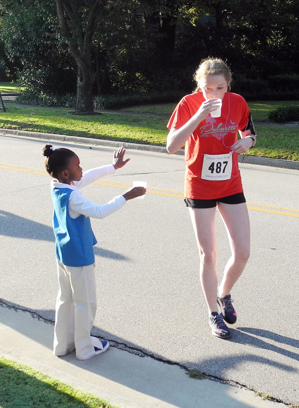 Girl Scout Daisy Troop 679 from St. Mark United Methodist Church provided cups of water for runners in Saturday's Forrest Ray 5K, one of several races in the Sumter Series.