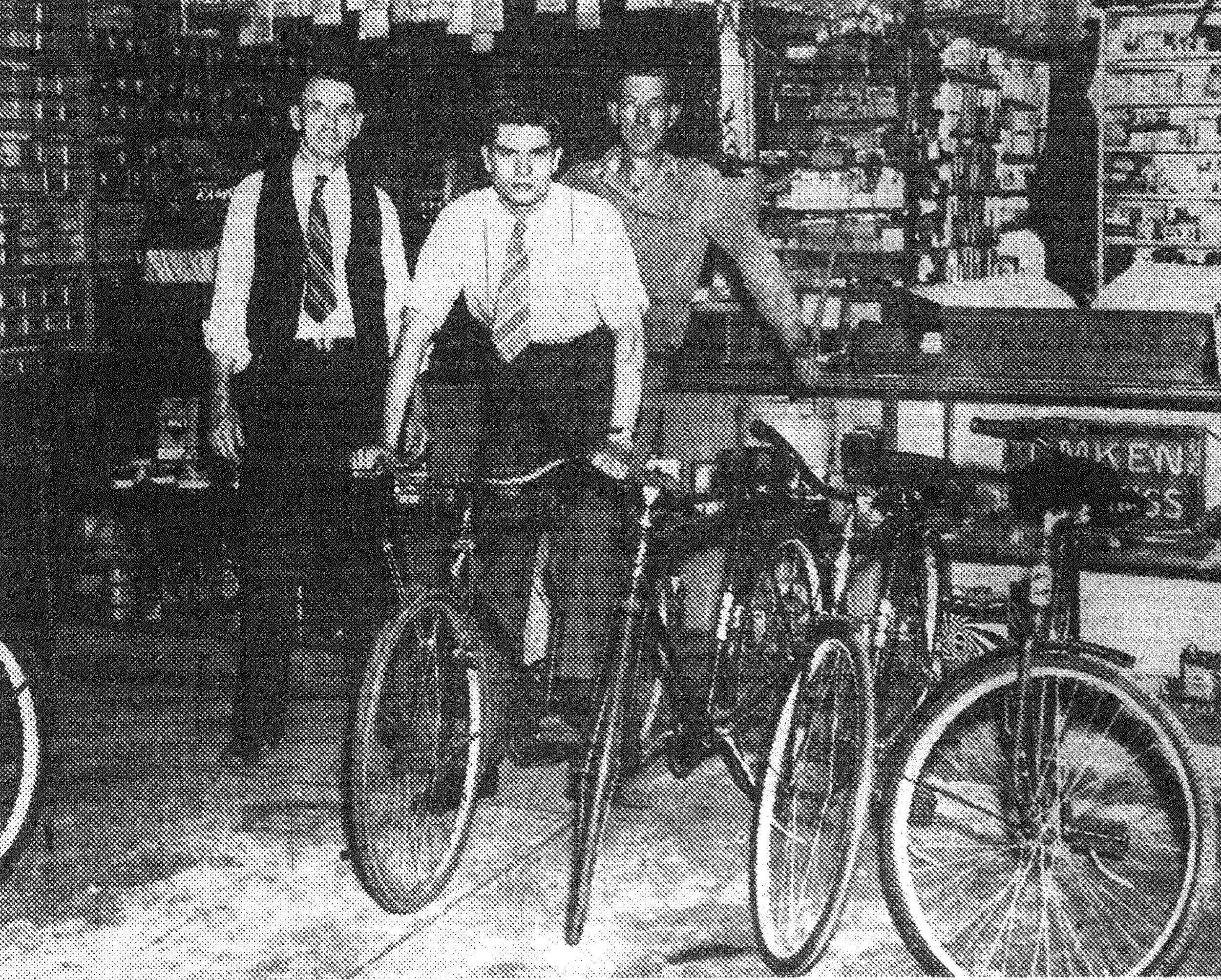 From 1943 - Pictured is Aubrey Hatfield mounted on the Victory bicycle he rode from Columbia to Sumter in three hours. At left is his father, A.J. Hatfield, owner of the bicycle and automobile accessories business that bears his name, and at right is Jim Shirer, bicycle repairman for A.J. Hatfield.