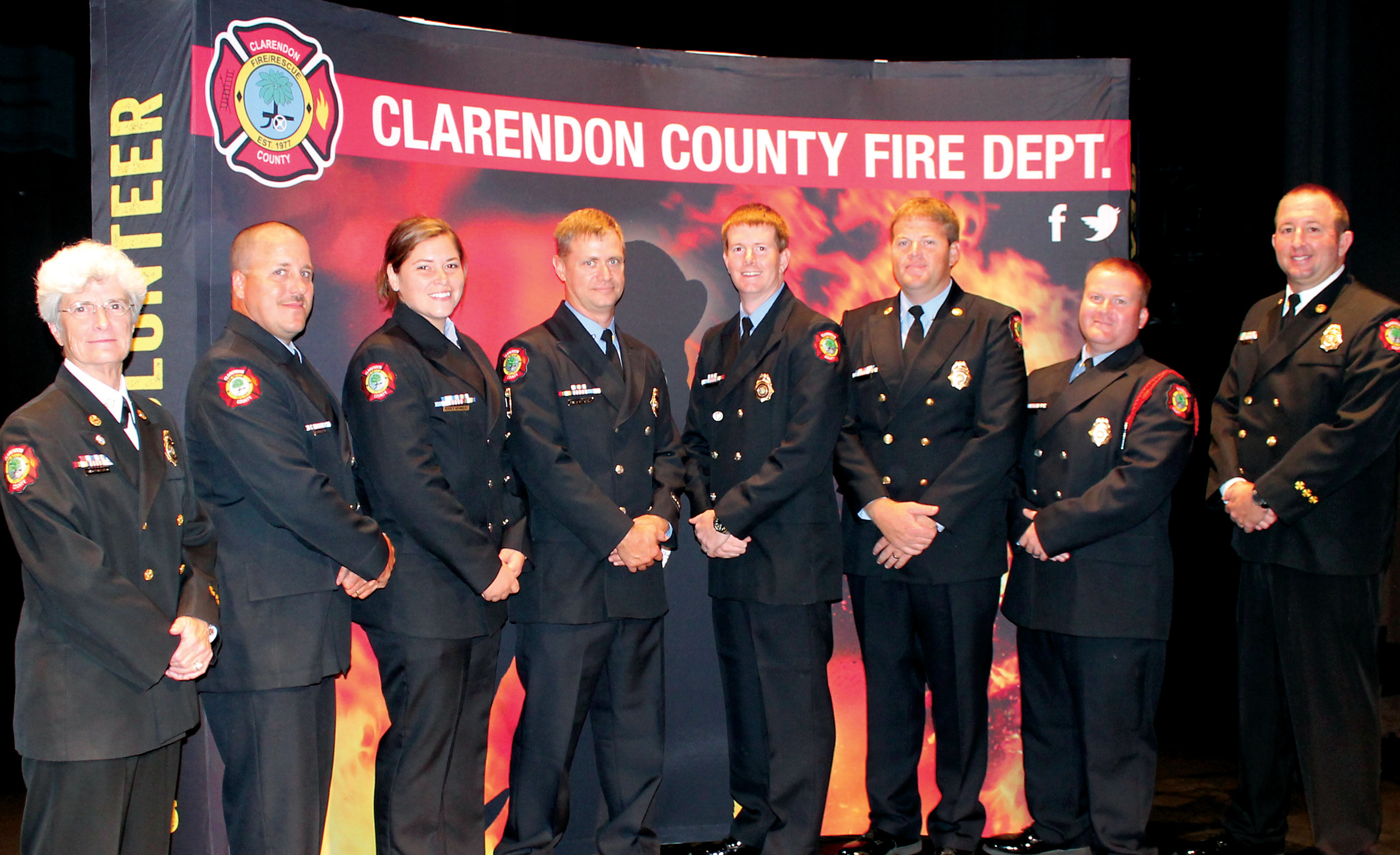 SHARRON HALEY / THE SUMTER ITEMSix career firefighters with the Clarendon County Fire Department were promoted during the department's Sept. 19 recruit graduation ceremony. Shown are Clarendon County Fire Chief Frances Richbourg alongside the newly promoted firefighters: Lt. Joseph McLeod, Lt. D. Mitchum, Lt. Jessica Weinberg, Capt. Michael Cothran, Captain F.B. Jones and Capt. Lee Mahoney with Deputy Chief Michael Johnson.