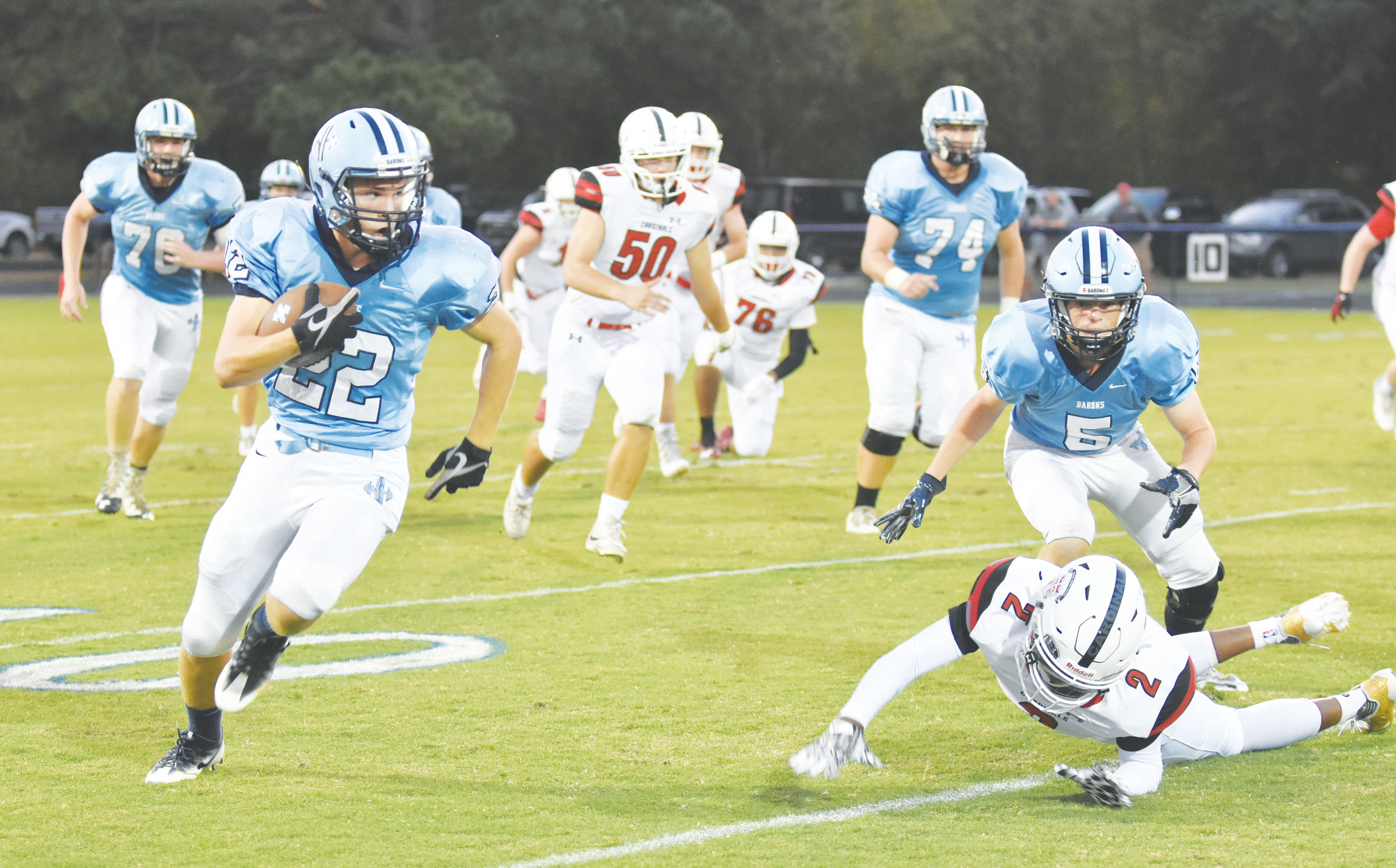 Wilson Hall running back Justin Timmons (22) and the Barons look to continue their recent success today when they travel to Dalzell to face Thomas Sumter Academy at 7:30 p.m.
