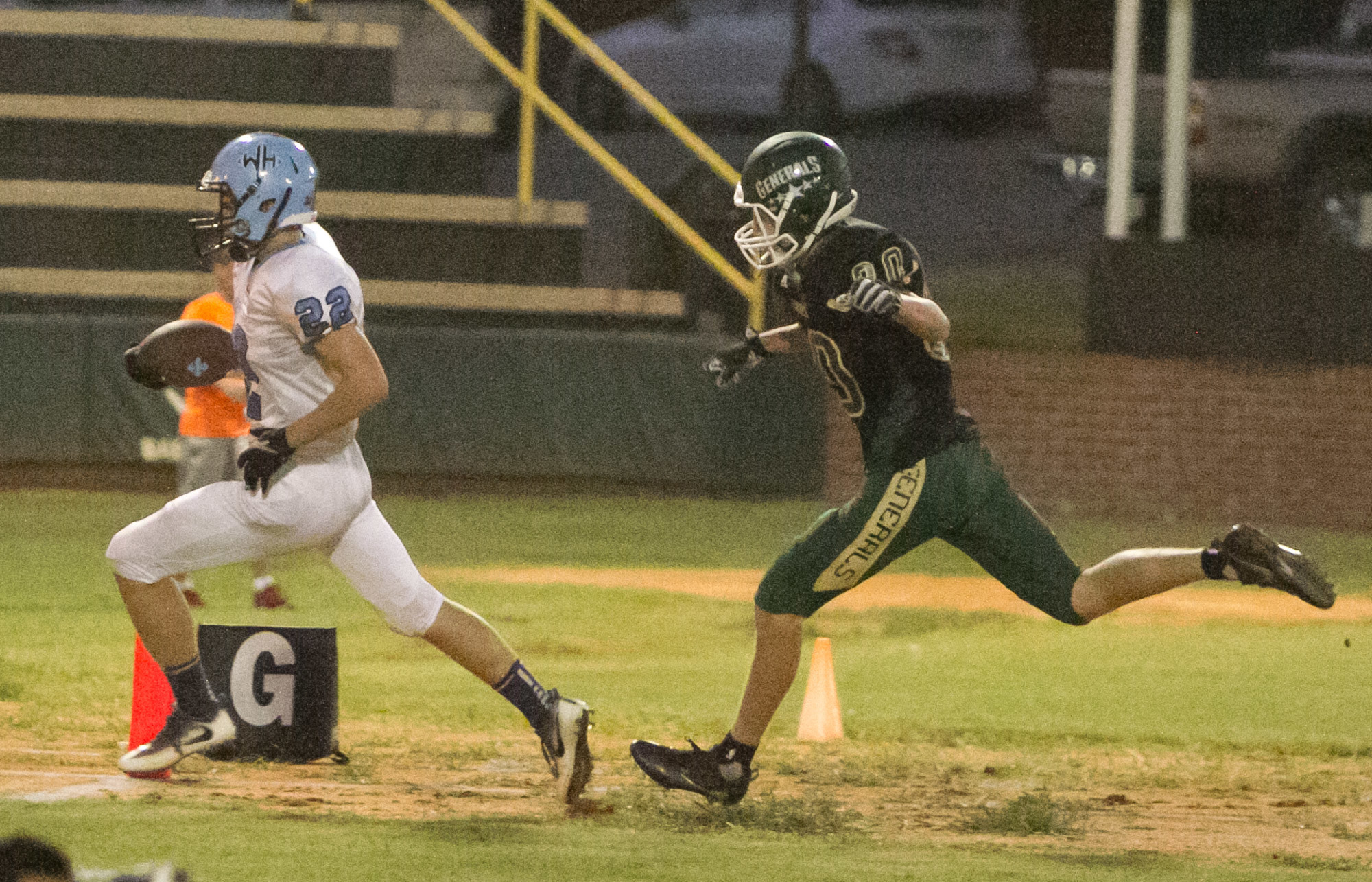 Wilson Hall's Justin Timmons (22) outruns Thomas Sumter Academy defender Zach Fugate for a touchdown during the Barons' 35-7 victory on Friday at General Field in Dalzell.