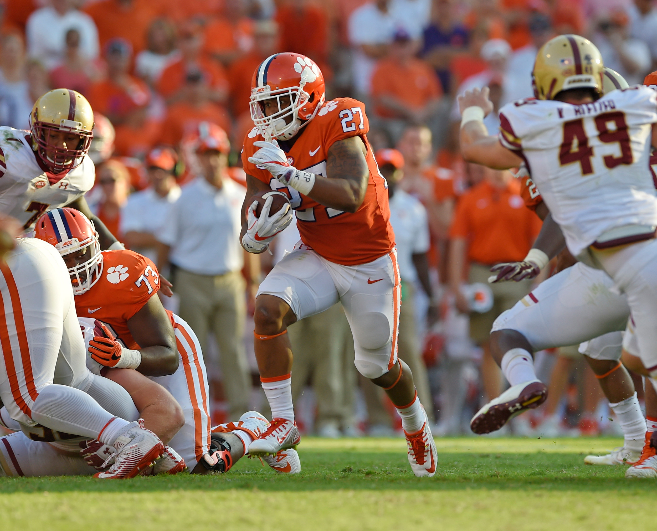 THE ASSOCIATED PRESSClemson running back C.J. Fuller (27) breaks out of the backfield for a first down during the Tigers' 34-7 victory over Boston College on Saturday in Clemson.
