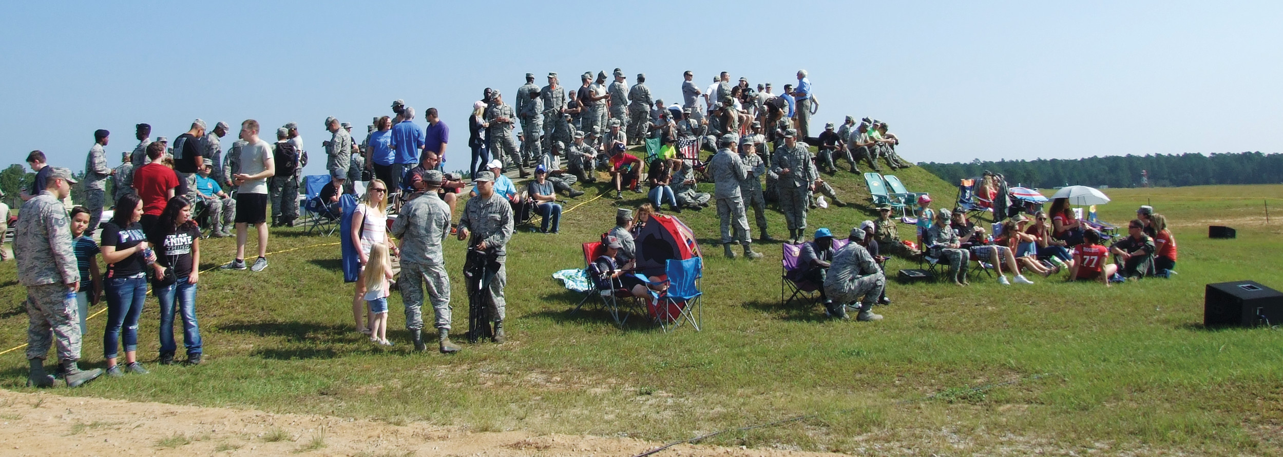 "About 400 people, many of them friends and family of the 77th Fighter ""Gambler"" Squadron at Shaw Air Force Base, came out to the squadron's ""Range Day"" demonstration at Poinsett Electronic Combat Range near Pinewood on Friday for air-to-ground and air-to-air combat simulations."