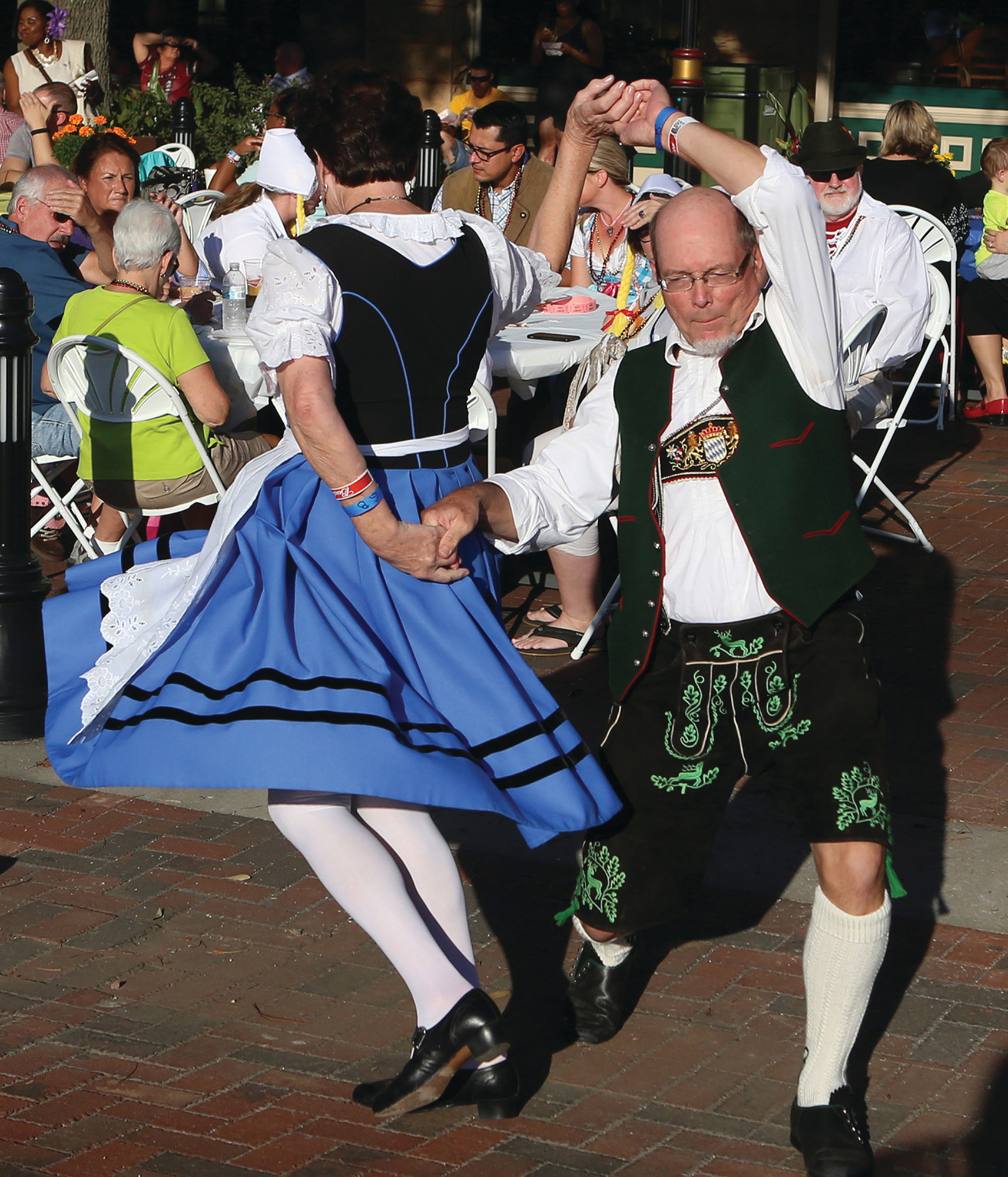 German costumes seem to add to the fun of German dancing during a past Oktoberfest on Sumter's Main Street.