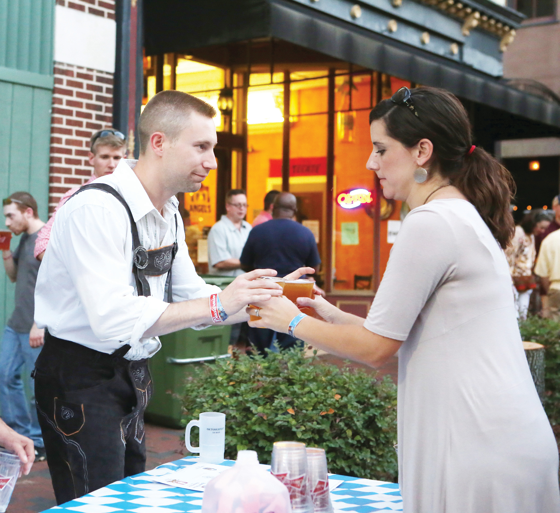 Brett Shilling receives a pair of beers from volunteer Lauren Barkley at a past Oktoberfest on Main.