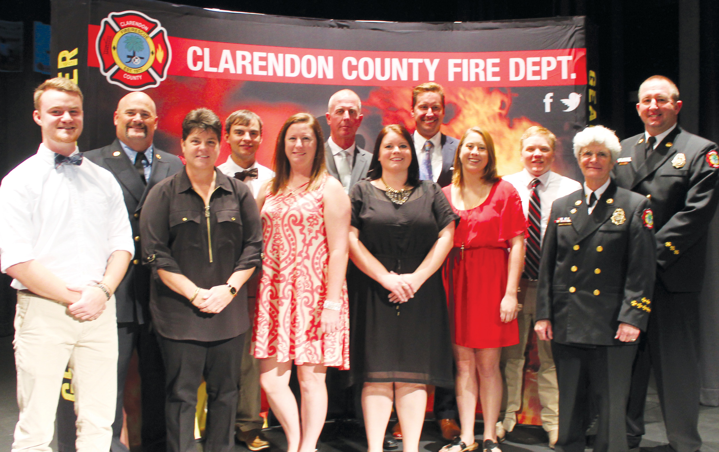 SHARRON HALEY / THE SUMTER ITEMThe Clarendon County Fire Department welcomed nine new firefighters following the department's their Sept. 19 Recruit Graduation Ceremony. Shown are new firefighter Chance T. Welch, Lt. Casey Connors, new firefighters Crystal M. Miller, Joshua M. Holladay, Courtney Atkinson, John L. Weeks, Chancely C. Coker, J. Matt Bradshaw, Brittani N. Bensoussan and James C. Bagnal, Clarendon County Fire Chief Frances Richbourg and Deputy Chief of Operations Michael Johnson.
