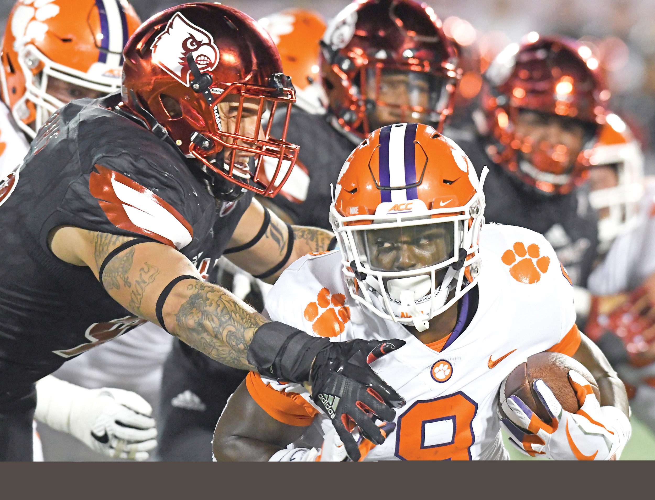 Clemson freshman Travis Etienne (9) has everything a tailback needs. He's got the speed as evidenced by his 81- and 50-yard TD runs the past two weeks. He also has power moves, as when he picked Clemson over his home-state school, LSU.